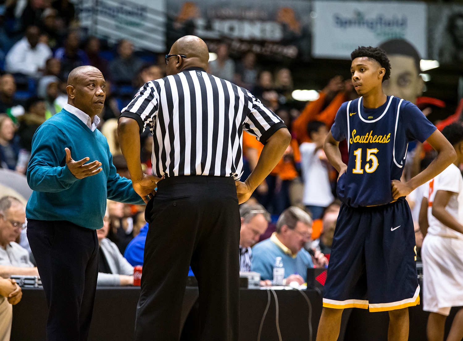 Southeast boys basketball head coach Lawrence Thomas talks with the referee after Southeast's James Dent (15) is called for his second technical and is ejected from the game as the Spartans take on Lanphier in the fourth quarter on opening night of the Boys City Tournament at the Bank of Springfield Center, Wednesday, Jan. 16, 2019, in Springfield, Ill. [Justin L. Fowler/The State Journal-Register]
