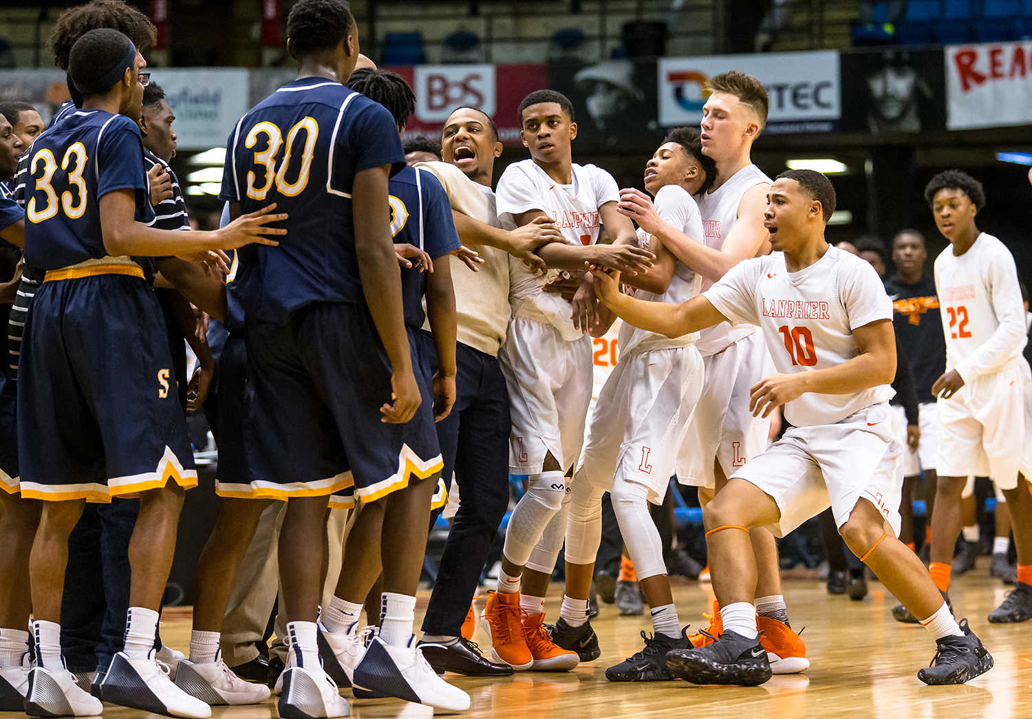 Lanphier's Larry Hemingway (4) his held back by an assistant coach as the Lions and Spartans get into a shoving match in the fourth quarter on opening night of the Boys City Tournament at the Bank of Springfield Center, Wednesday, Jan. 16, 2019, in Springfield, Ill. [Justin L. Fowler/The State Journal-Register]