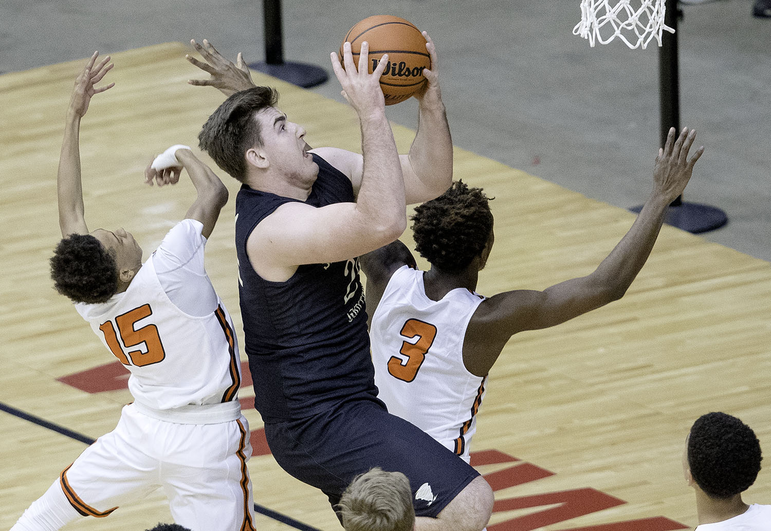 Sacred Heart-Griffin's Nick Broeker beats Lanphier's Maki Rose and Karl Wright to the hoop during the Boys City Tournament at the Bank of Springfield Center Thursday, Jan. 17, 2019.  [Ted Schurter/The State Journal-Register]