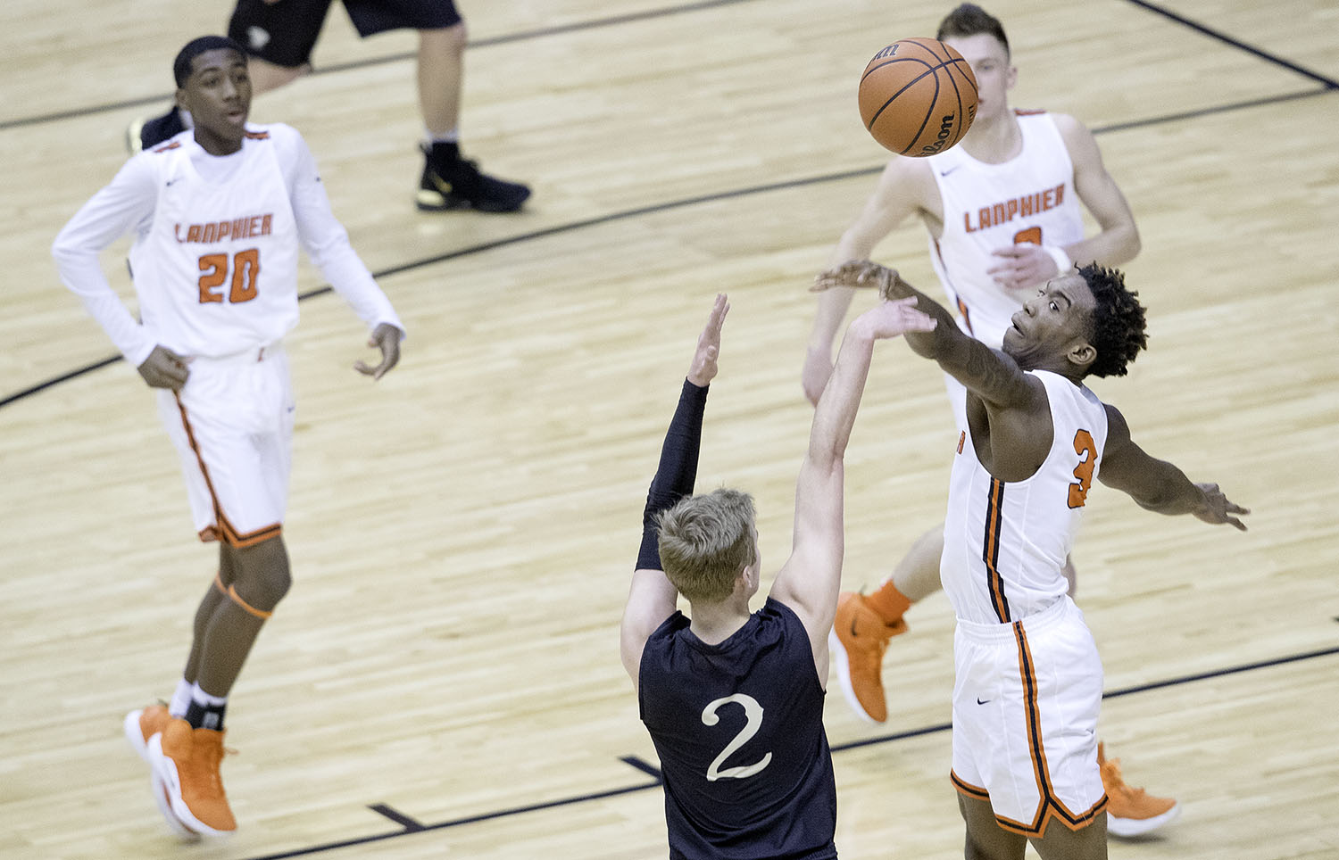 Sacred Heart-Griffin's Joe Gustafson fires a three under pressure from Lanphier's Karl Wright during the Boys City Tournament at the Bank of Springfield Center Thursday, Jan. 17, 2019.  [Ted Schurter/The State Journal-Register]