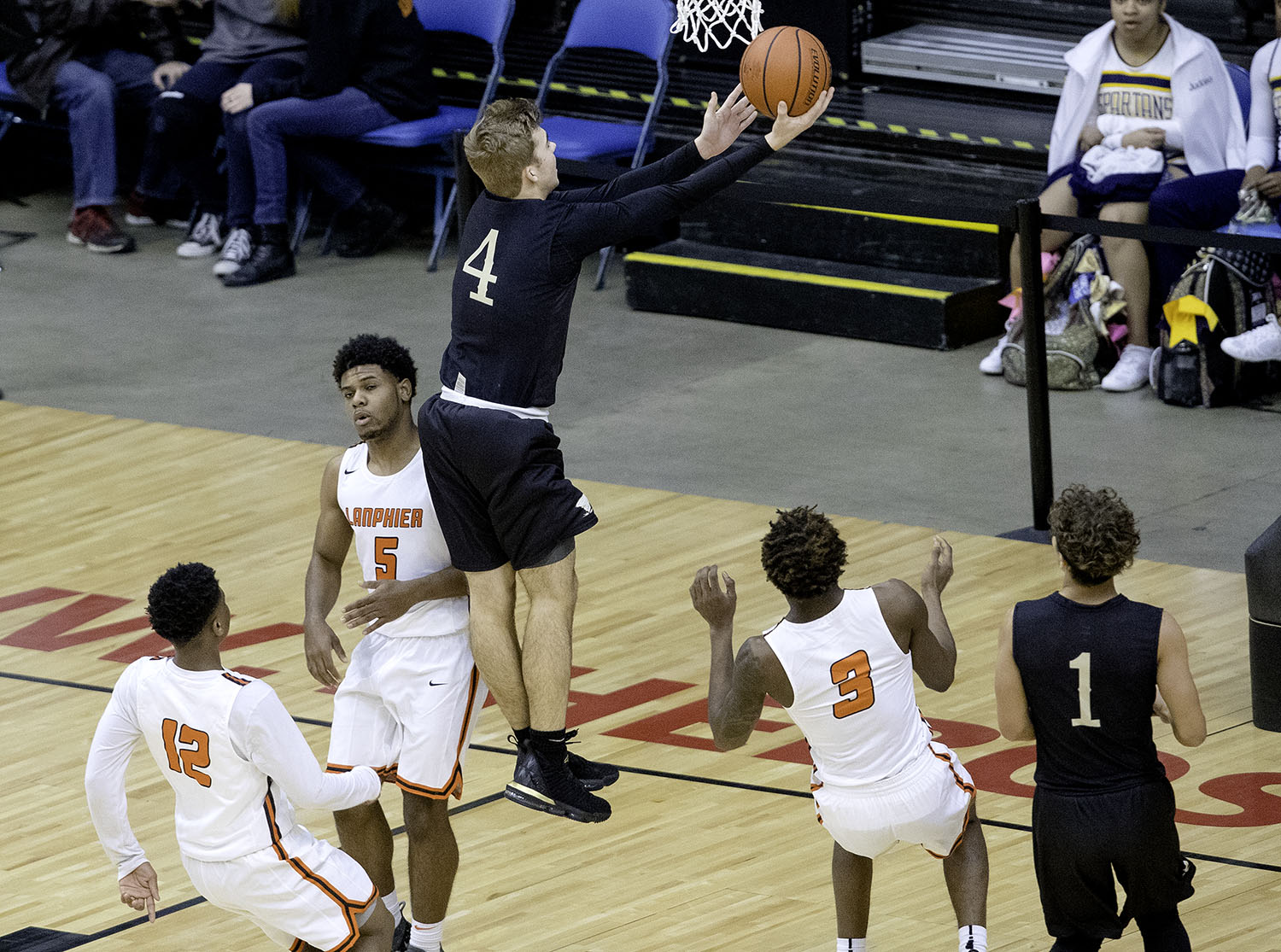 Sacred Heart-Griffin's Charlie Hamilton drives past Lanphier's Stanley Morgan  on his way to the hoop during the Boys City Tournament at the Bank of Springfield Center Thursday, Jan. 17, 2019.  [Ted Schurter/The State Journal-Register]