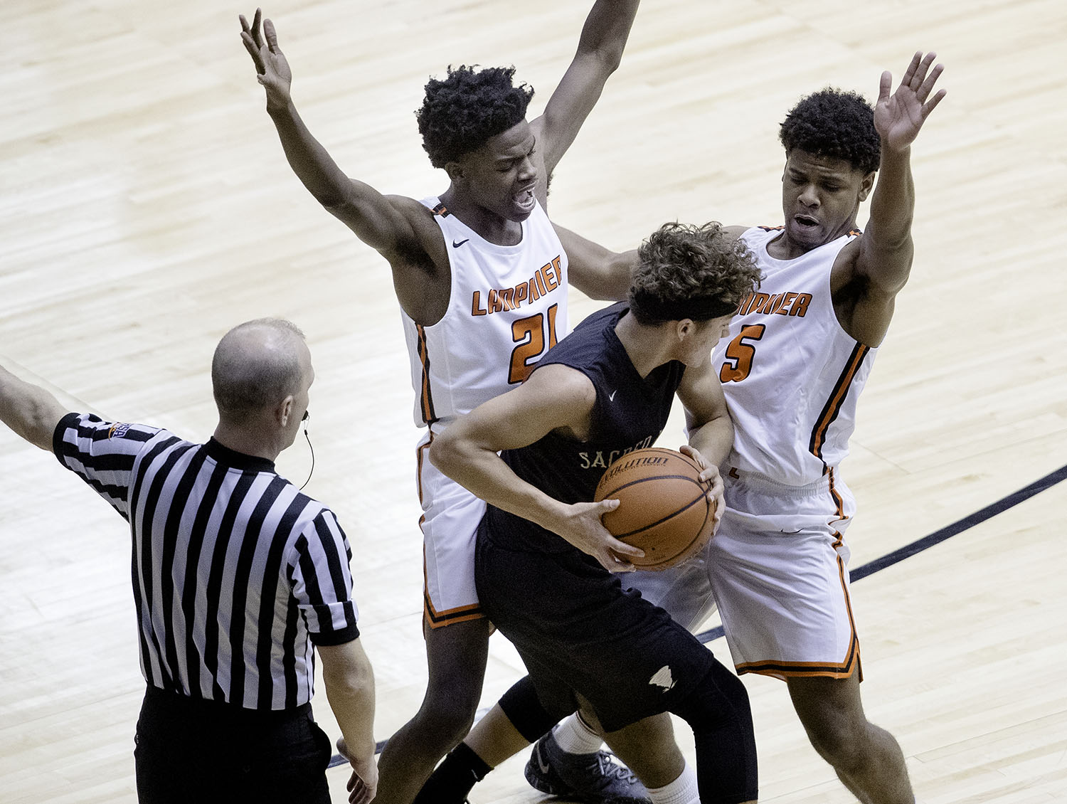 Lanphier's Deandre White and Stanley Morgan  contain Sacred Heart-Griffin's Isaiah Thompson on the perimeter during the Boys City Tournament at the Bank of Springfield Center Thursday, Jan. 17, 2019.  [Ted Schurter/The State Journal-Register]