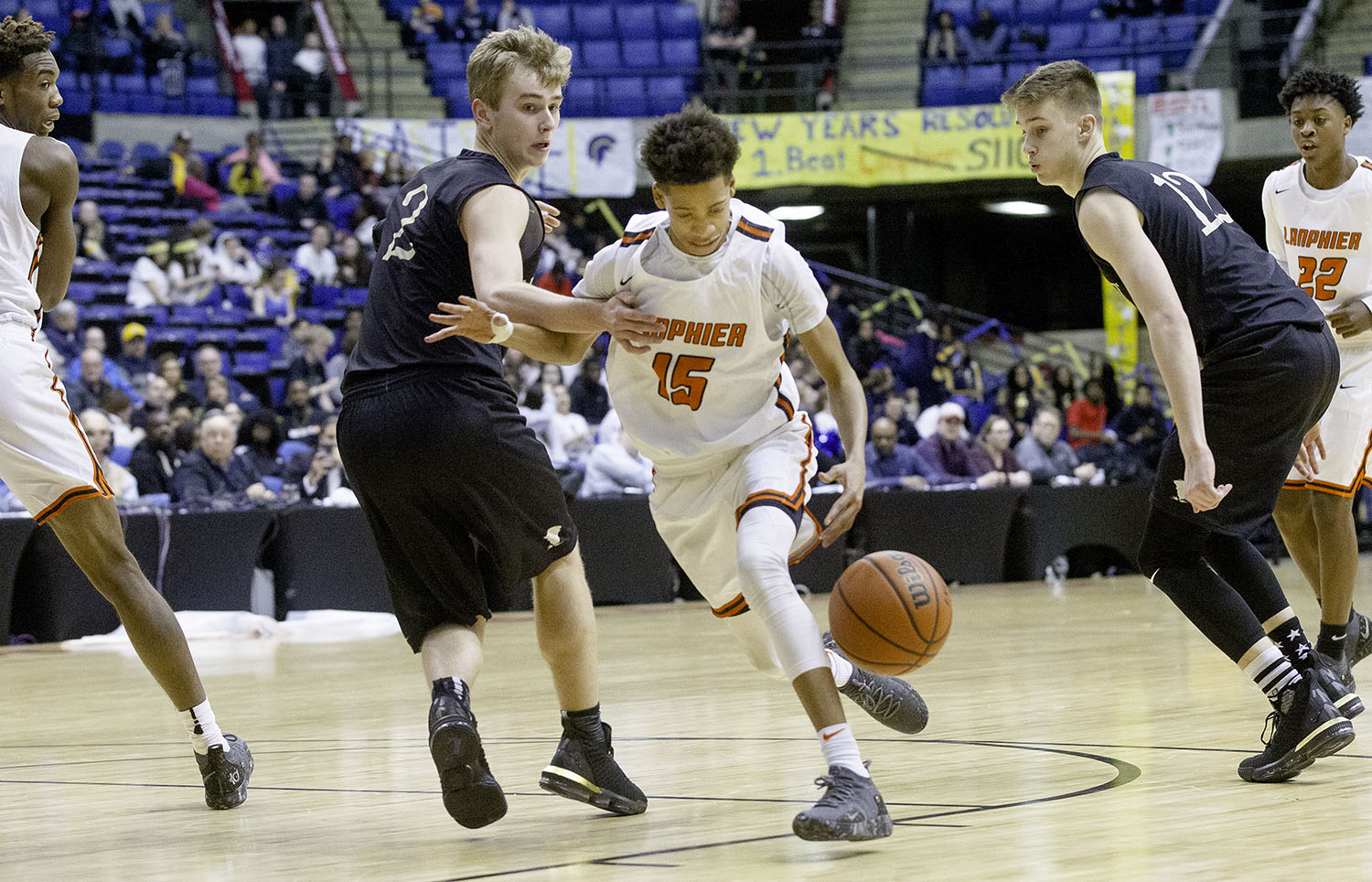 Lanphier's Maki Rose drives past Sacred Heart-Griffin's Joe Gustafson during the Boys City Tournament at the Bank of Springfield Center Thursday, Jan. 17, 2019.  [Ted Schurter/The State Journal-Register]
