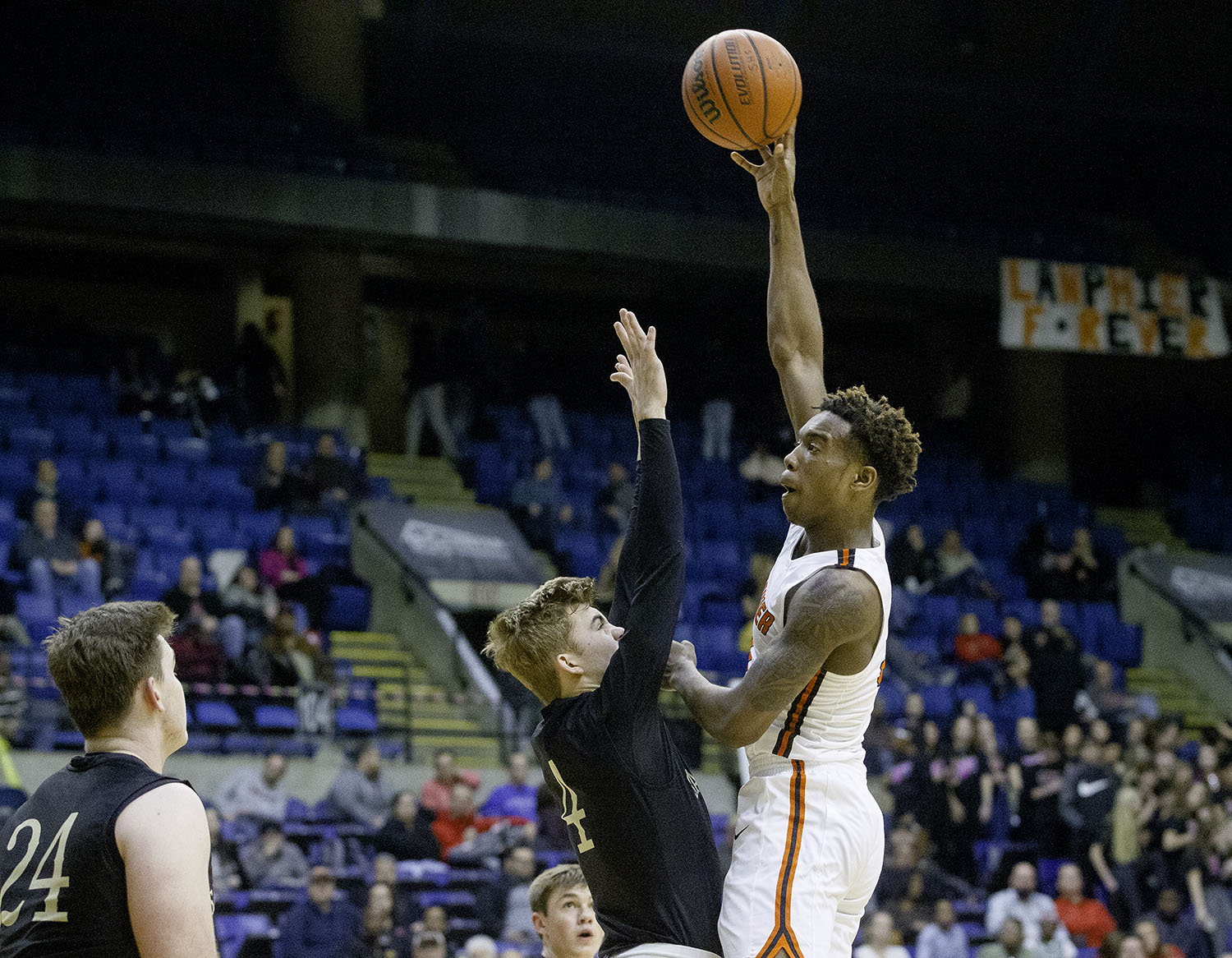 Lanphier's Karl Wright scores over Sacred Heart-Griffin's Charlie Hamilton during the Boys City Tournament at the Bank of Springfield Center Thursday, Jan. 17, 2019.  [Ted Schurter/The State Journal-Register]