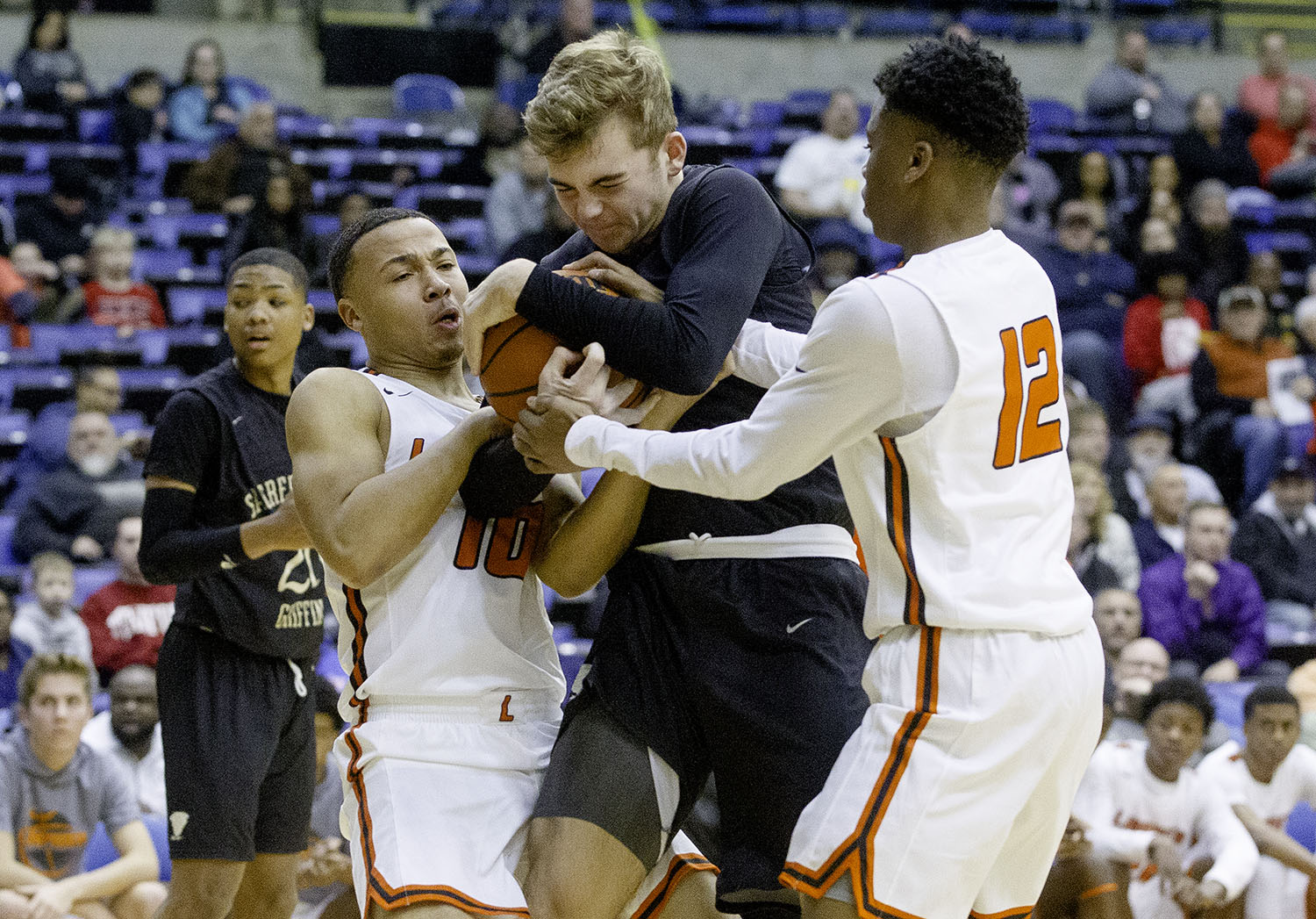 Sacred Heart-Griffin's Charlie Hamilton fights to keep the ball against Lanphier's Shain Chairs and AJ Frazier during the Boys City Tournament at the Bank of Springfield Center Thursday, Jan. 17, 2019.  [Ted Schurter/The State Journal-Register]