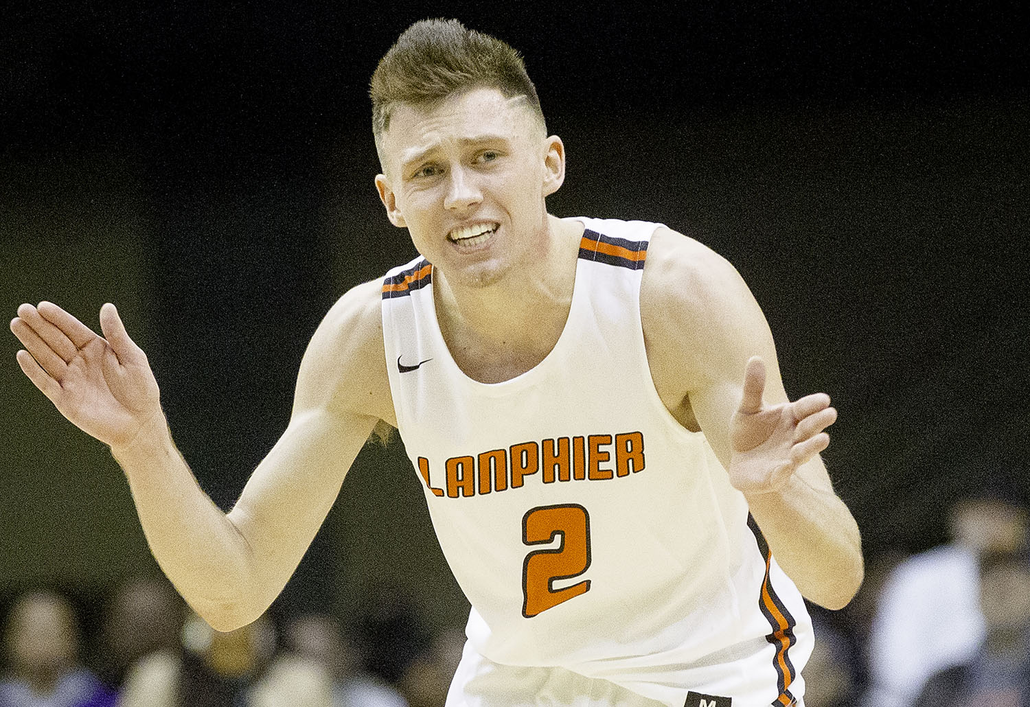 Lanphier's Jaden Snodgrass tries to motivate the Lions as the mount a comeback against Sacred Heart-Griffin during the Boys City Tournament at the Bank of Springfield Center Thursday, Jan. 17, 2019.  [Ted Schurter/The State Journal-Register]
