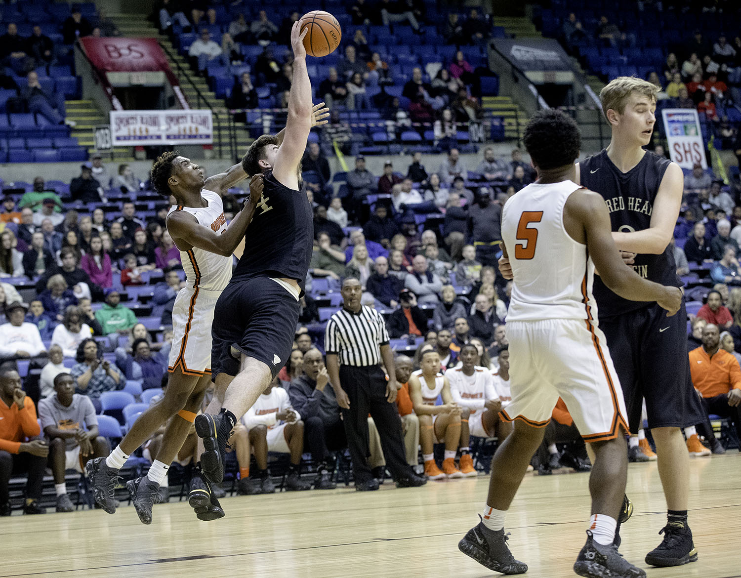 Sacred Heart-Griffin's Nick Broeker intercepts a pass intended for Lanphier's Karl Wright during the Boys City Tournament at the Bank of Springfield Center Thursday, Jan. 17, 2019.  [Ted Schurter/The State Journal-Register]