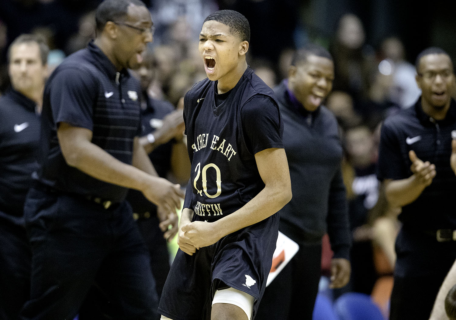 Sacred Heart-Griffin Andrew Schluter celebrates after the Cyclones defeated Lanphier during the Boys City Tournament at the Bank of Springfield Center Thursday, Jan. 17, 2019.  [Ted Schurter/The State Journal-Register]