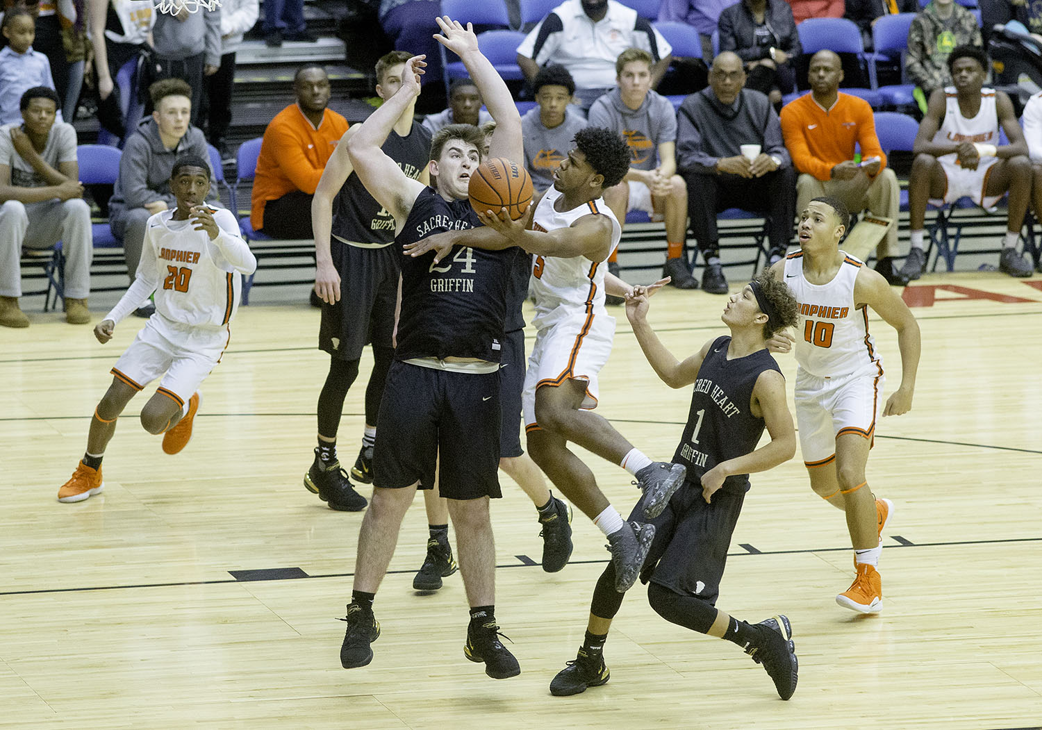 Lanphier's Stanley Morgan  drives past Sacred Heart-Griffin's Nick Broeker during the Boys City Tournament at the Bank of Springfield Center Thursday, Jan. 17, 2019.  [Ted Schurter/The State Journal-Register]