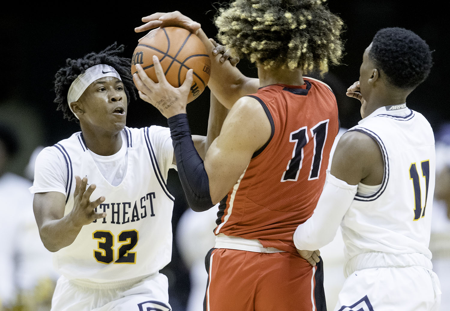 Southeast's Stepheon Sims, left, and Antron Bevly pressure Springfield's Zaire Harris during the Boys City Tournament at the Bank of Springfield Center Thursday, Jan. 17, 2019.  [Ted Schurter/The State Journal-Register]