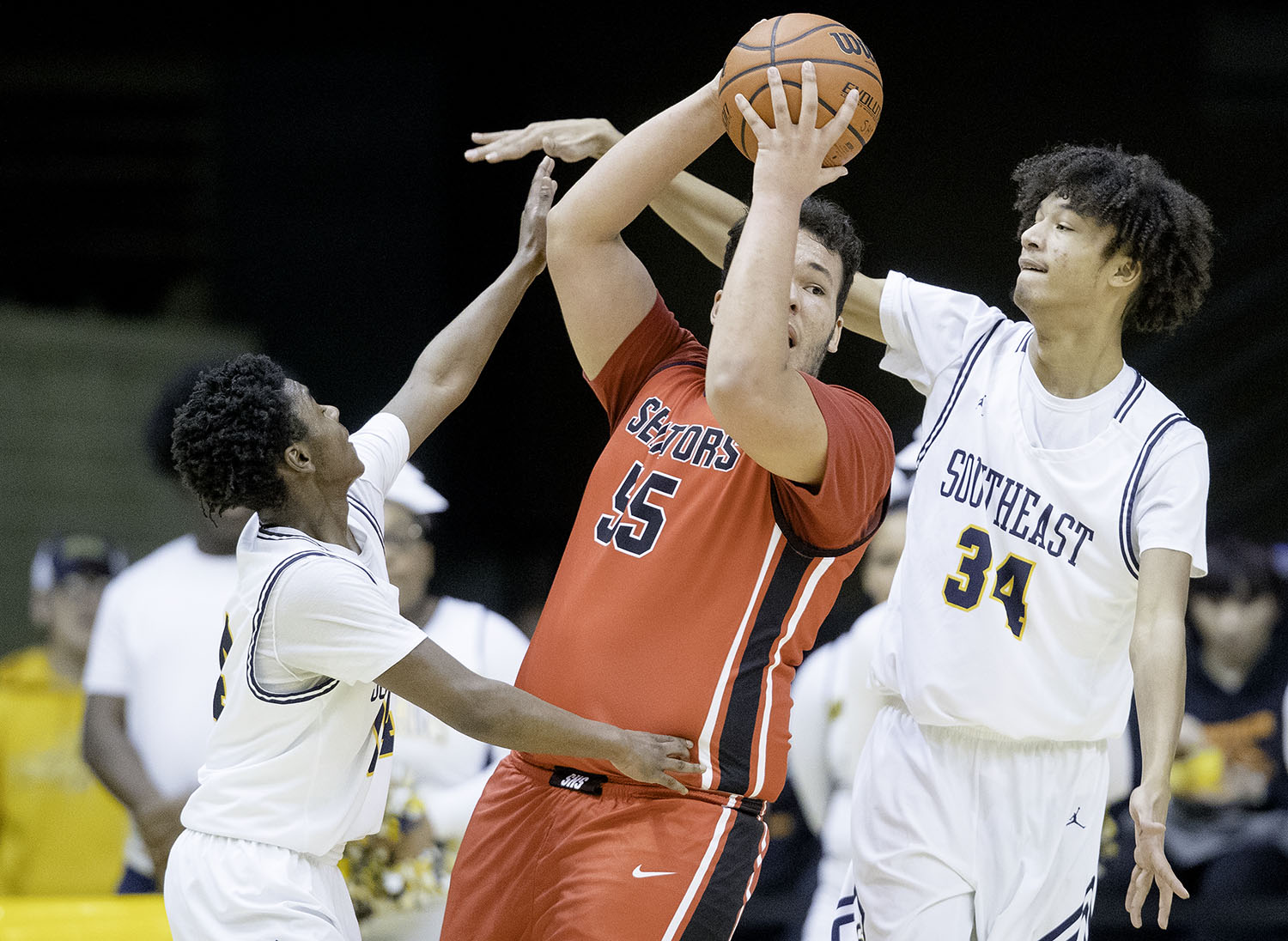 Springfield's Nate Borders looks for an open teammate under pressure from Southeast's Michael Taylor during the Boys City Tournament at the Bank of Springfield Center Thursday, Jan. 17, 2019.  [Ted Schurter/The State Journal-Register]