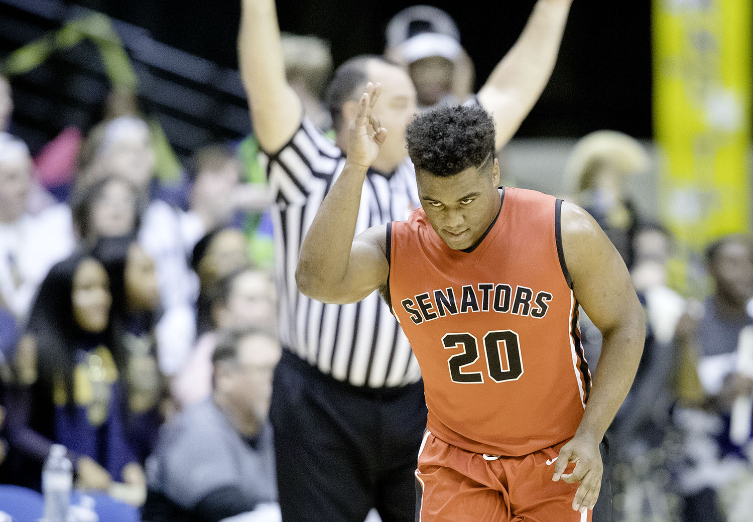 Springfield's Caleb Small celebrates a trey against Southeast during the Boys City Tournament at the Bank of Springfield Center Thursday, Jan. 17, 2019.  [Ted Schurter/The State Journal-Register]