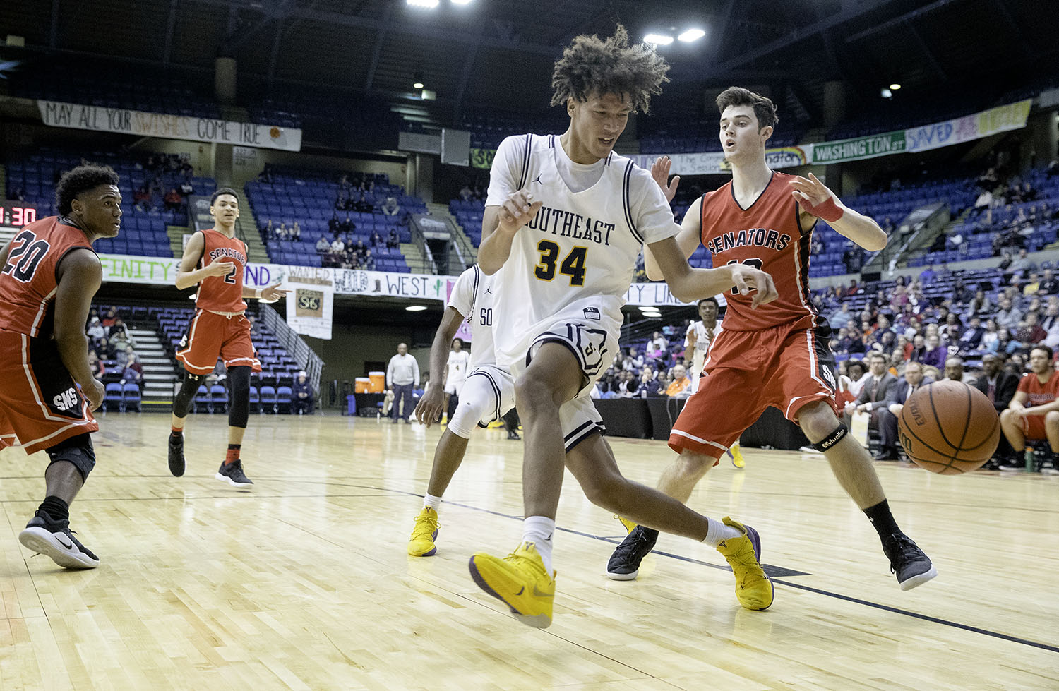 Southeast's Michael Taylor looses control of the ball under pressure from Springfield during the Boys City Tournament at the Bank of Springfield Center Thursday, Jan. 17, 2019.  [Ted Schurter/The State Journal-Register]