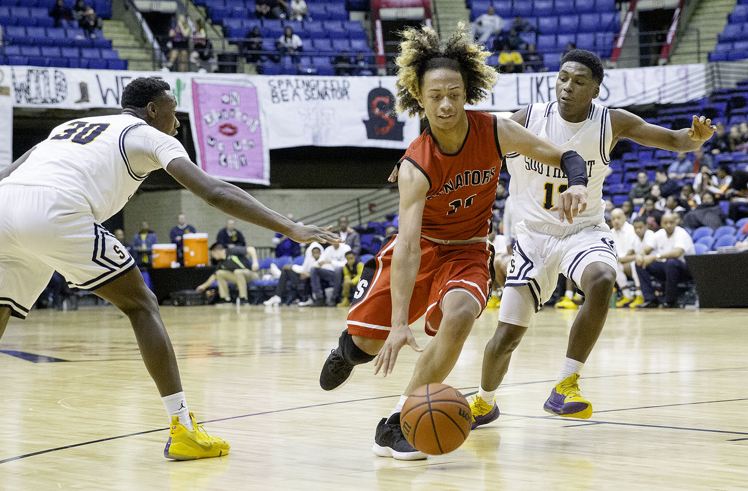 Springfield's Zaire Harris drives past Southeast's Devin Blue-Robinson during the Boys City Tournament at the Bank of Springfield Center Thursday, Jan. 17, 2019.  [Ted Schurter/The State Journal-Register]