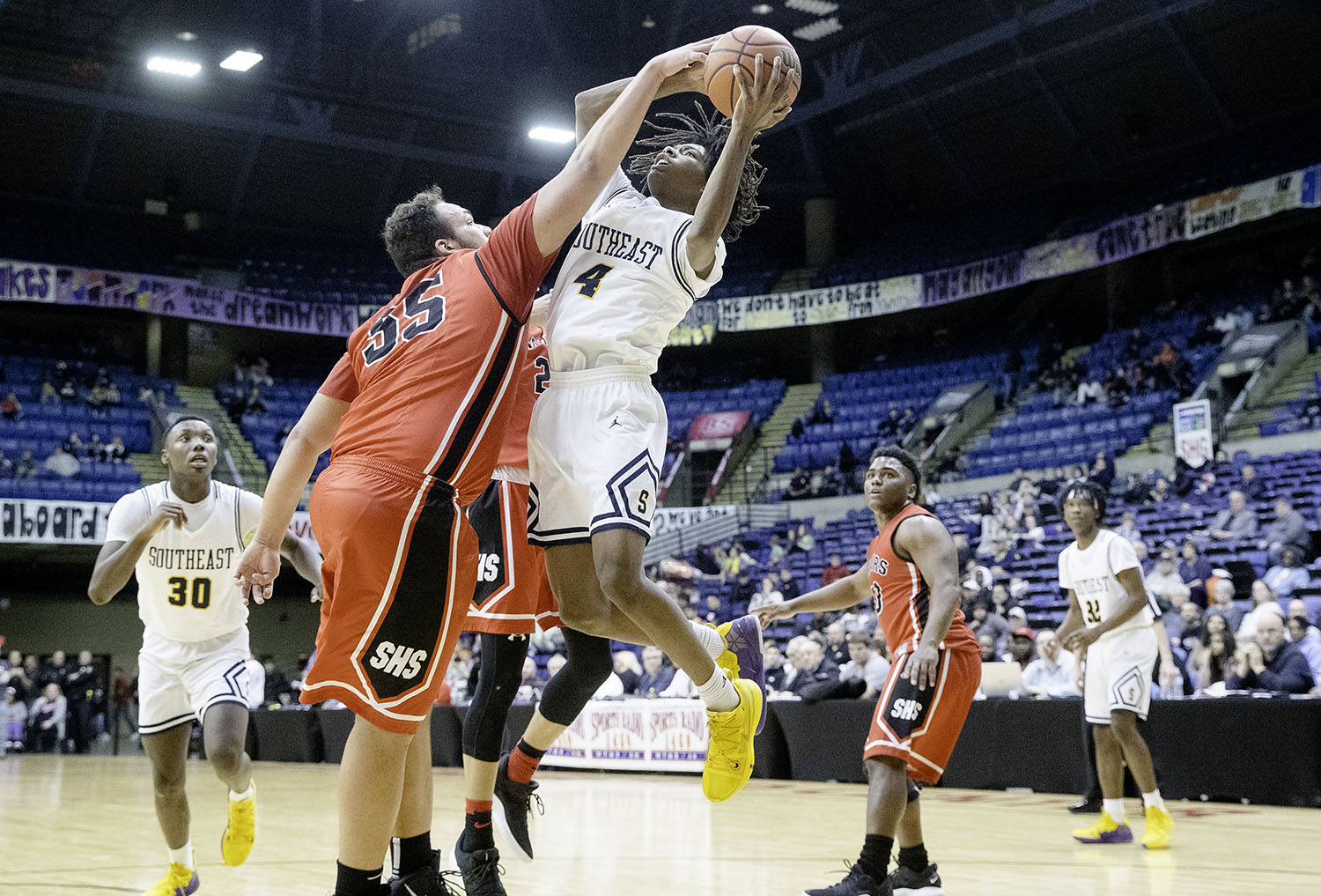 Springfield's Nate Borders fouls Southeast's Terrion Murdix during the Boys City Tournament at the Bank of Springfield Center Thursday, Jan. 17, 2019.  [Ted Schurter/The State Journal-Register]