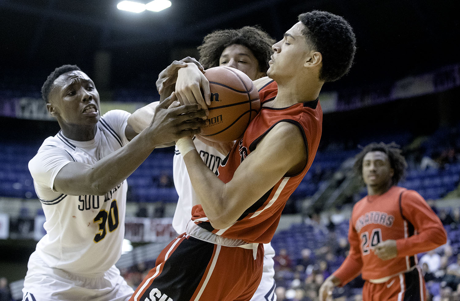 Southeast's Devin Blue-Robinson and Southeast's Michael Taylor pressure Springfield's Bennie Slater as he grabs a rebound during the Boys City Tournament at the Bank of Springfield Center Thursday, Jan. 17, 2019.  [Ted Schurter/The State Journal-Register]