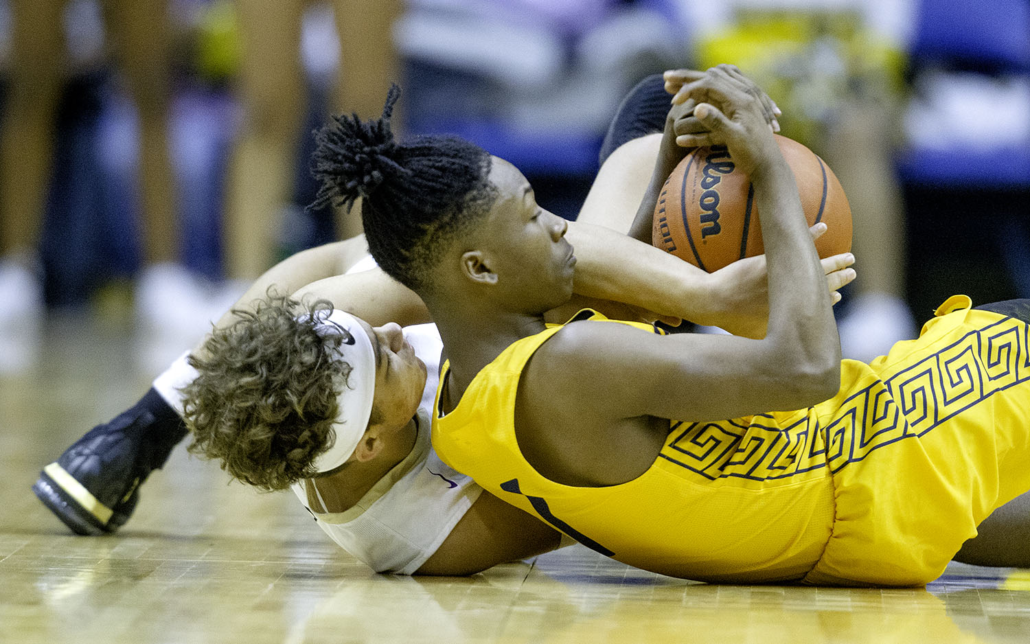 Sacred Heart-Griffin's Isaiah Thompson and Southeast's Stepheon Sims fight for control of a loose ball during the Boys City Tournament at the Bank of Springfield Center Friday, Jan. 18, 2019.  [Ted Schurter/The State Journal-Register]