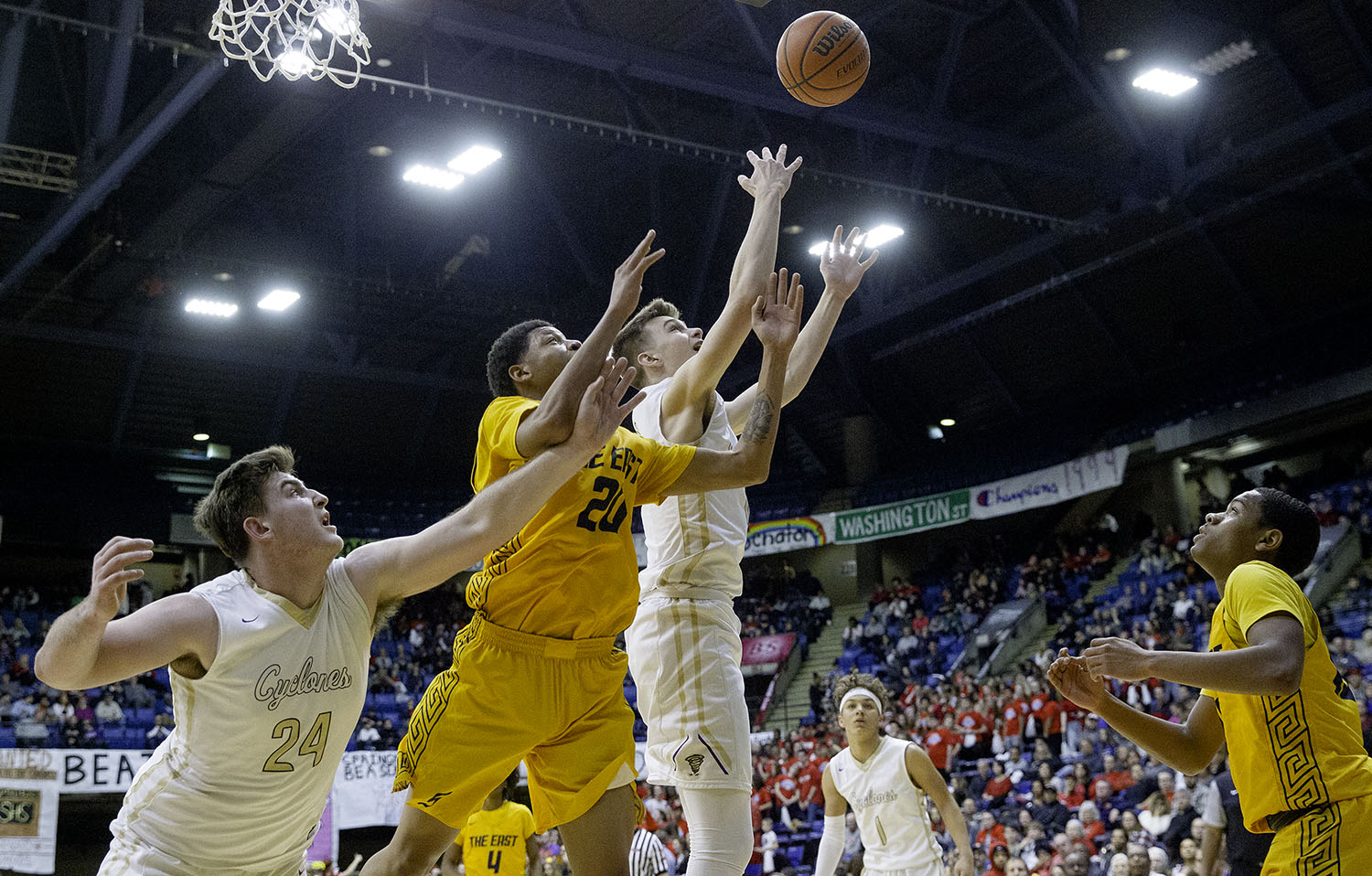 Sacred Heart-Griffin's Nick Broeker and Kyle Ingram try to beat Southeast's Abdur Muhammad to a rebound  during the Boys City Tournament at the Bank of Springfield Center Friday, Jan. 18, 2019.  [Ted Schurter/The State Journal-Register]