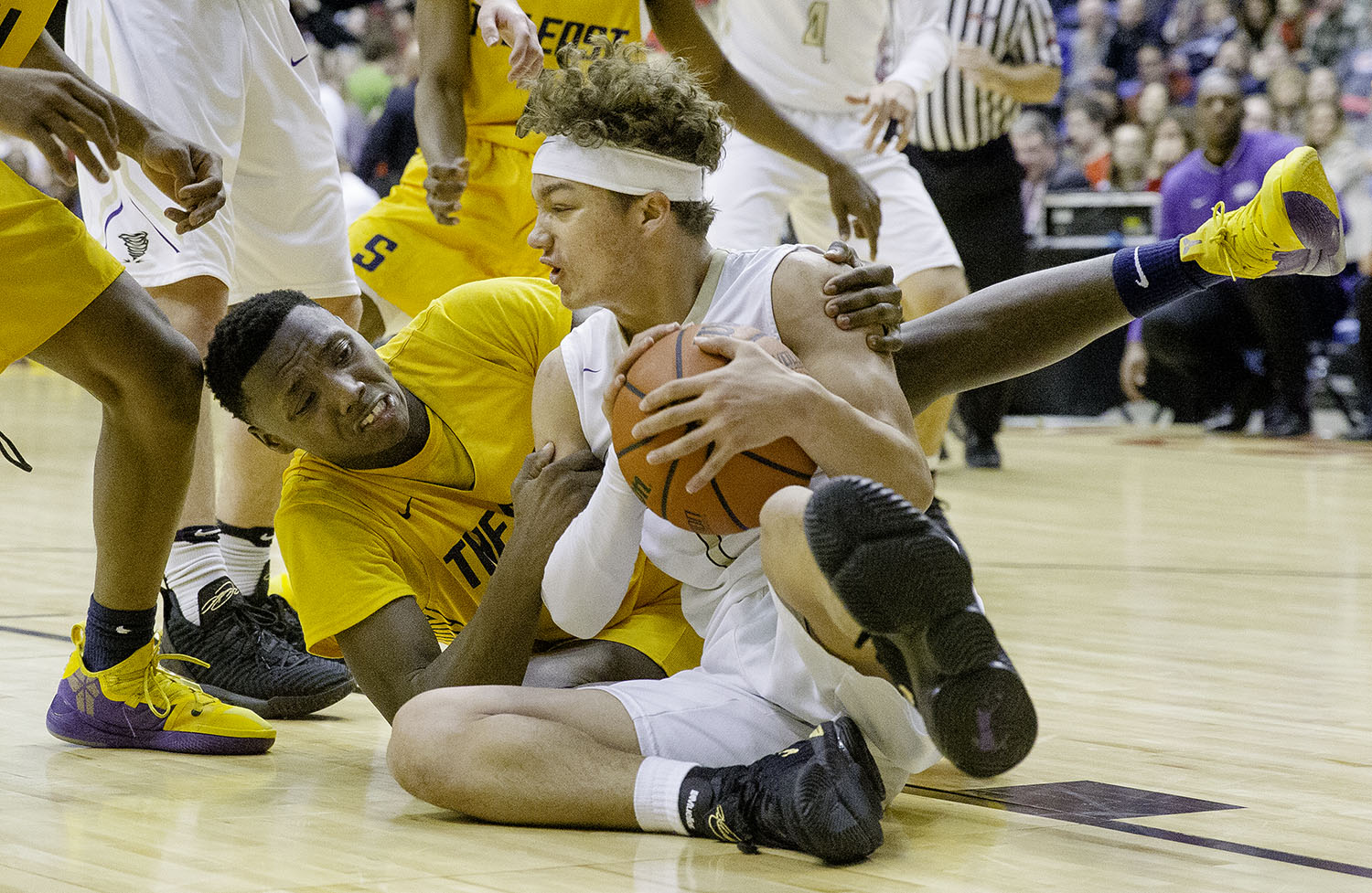 Sacred Heart-Griffin's Isaiah Thompson grabs a loose ball from Southeast's Devin Blue-Robinson during the Boys City Tournament at the Bank of Springfield Center Friday, Jan. 18, 2019.  [Ted Schurter/The State Journal-Register]