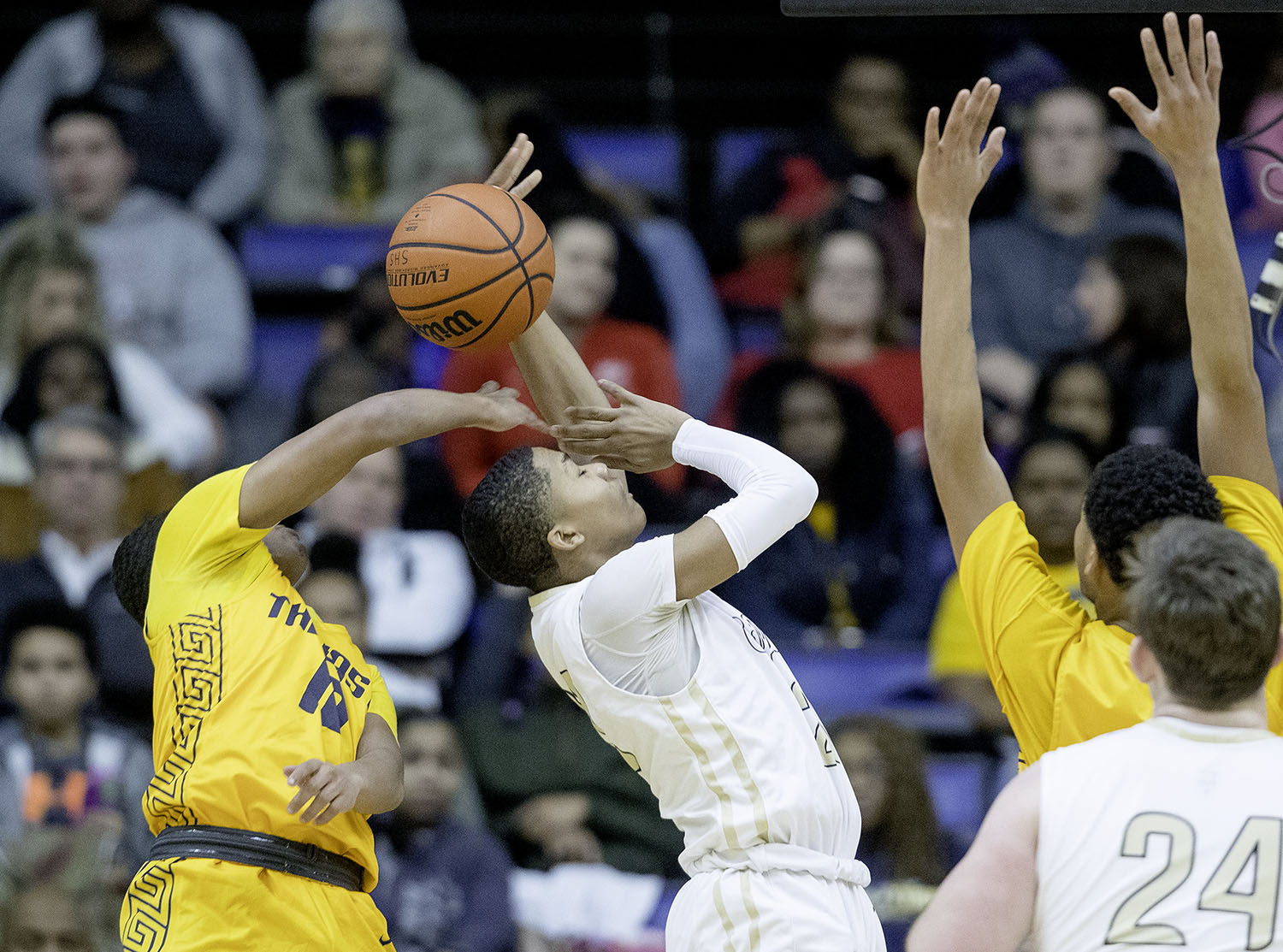 Southeast's Damon Davis blocks Sacred Heart-Griffin's Andrew Schluter during the Boys City Tournament at the Bank of Springfield Center Friday, Jan. 18, 2019.  [Ted Schurter/The State Journal-Register]