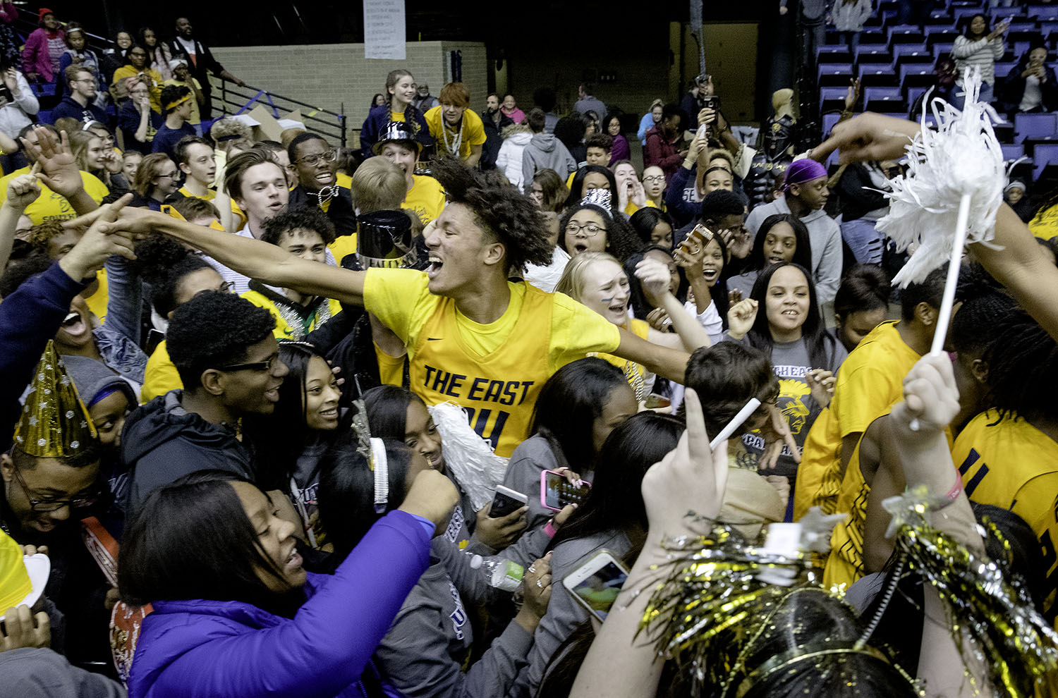 Southeast's Michael Taylor celebrates with the fans after the Spartans defeated Sacred Heart-Griffin during the Boys City Tournament at the Bank of Springfield Center Friday, Jan. 18, 2019.  [Ted Schurter/The State Journal-Register]