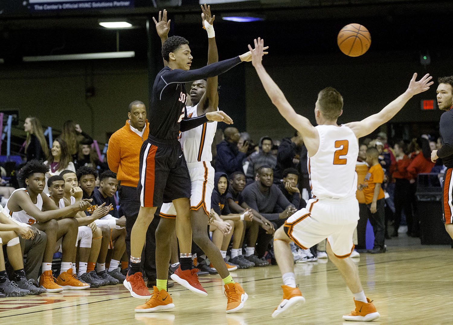 Springfield's Bennie Slater passes the ball out of double Lanphier coverage during the Boys City Tournament at the Bank of Springfield Center Friday, Jan. 18, 2019.  [Ted Schurter/The State Journal-Register]