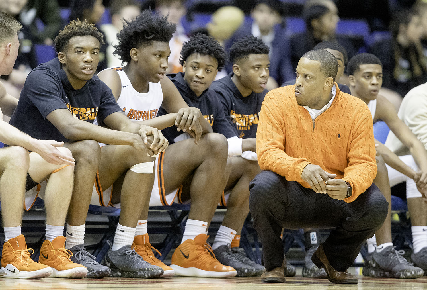 Lanphier head coach Blake Turner gives his bench a look as they fall behind by double digits in the first half against Springfield during the Boys City Tournament at the Bank of Springfield Center Friday, Jan. 18, 2019.  [Ted Schurter/The State Journal-Register]