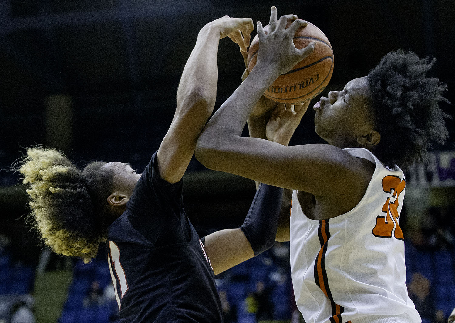 Lanphier's KJ Deberick grabs a rebound from Springfield's Zaire Harris during the Boys City Tournament at the Bank of Springfield Center Friday, Jan. 18, 2019.  [Ted Schurter/The State Journal-Register]
