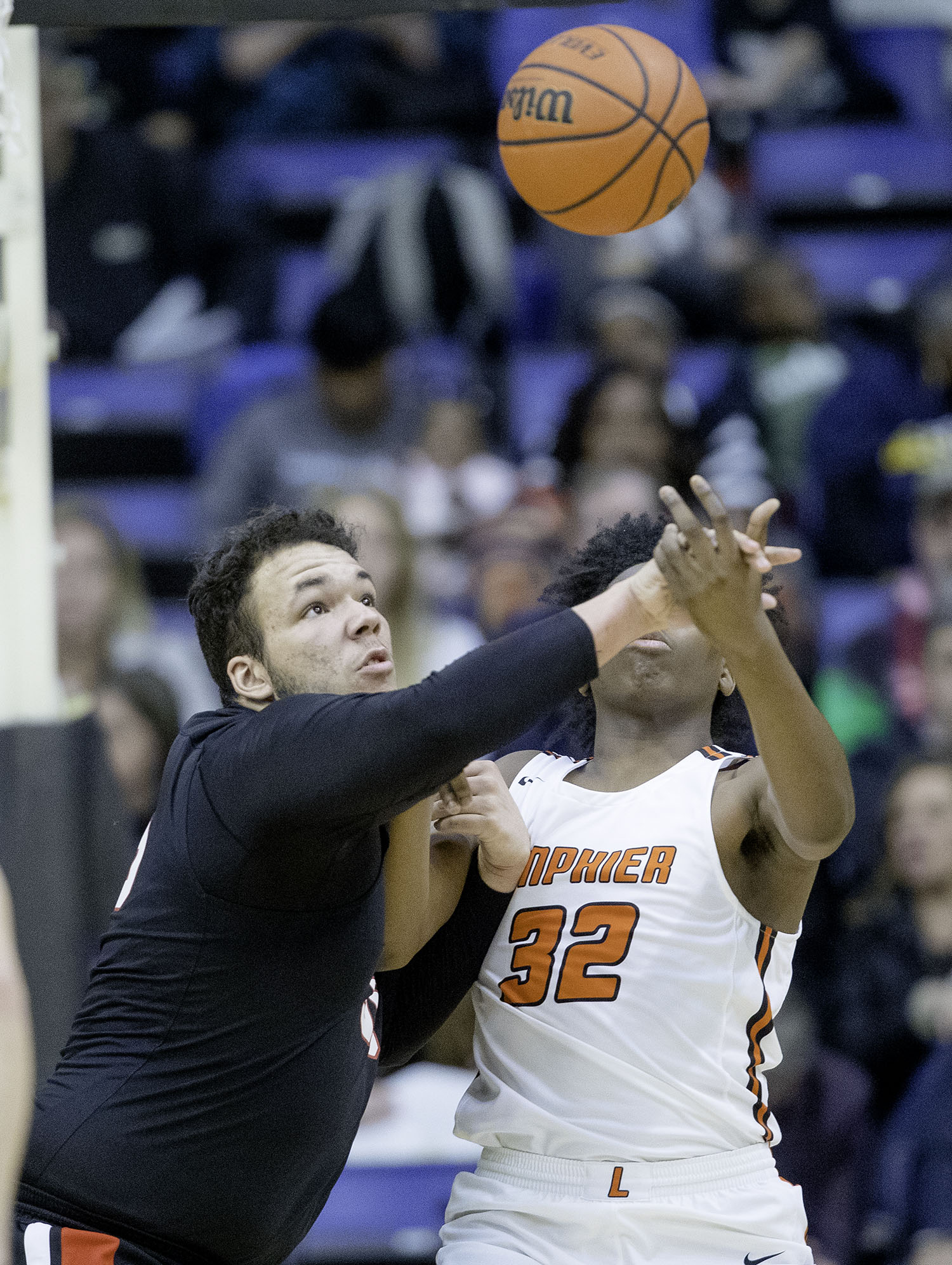 Springfield's Nate Borders and Lanphier's KJ Deberick fight for a rebound during the Boys City Tournament at the Bank of Springfield Center Friday, Jan. 18, 2019.  [Ted Schurter/The State Journal-Register]