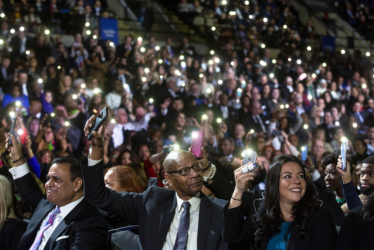 Audience members wave their cell phones to go with a song performed by Soul Children of Chicago during the Illinois Inaugural Ceremony Monday, Jan. 14, 2019 a the Bank of Springfield Center in Springfield, Ill. [Rich Saal/The State Journal-Register]
