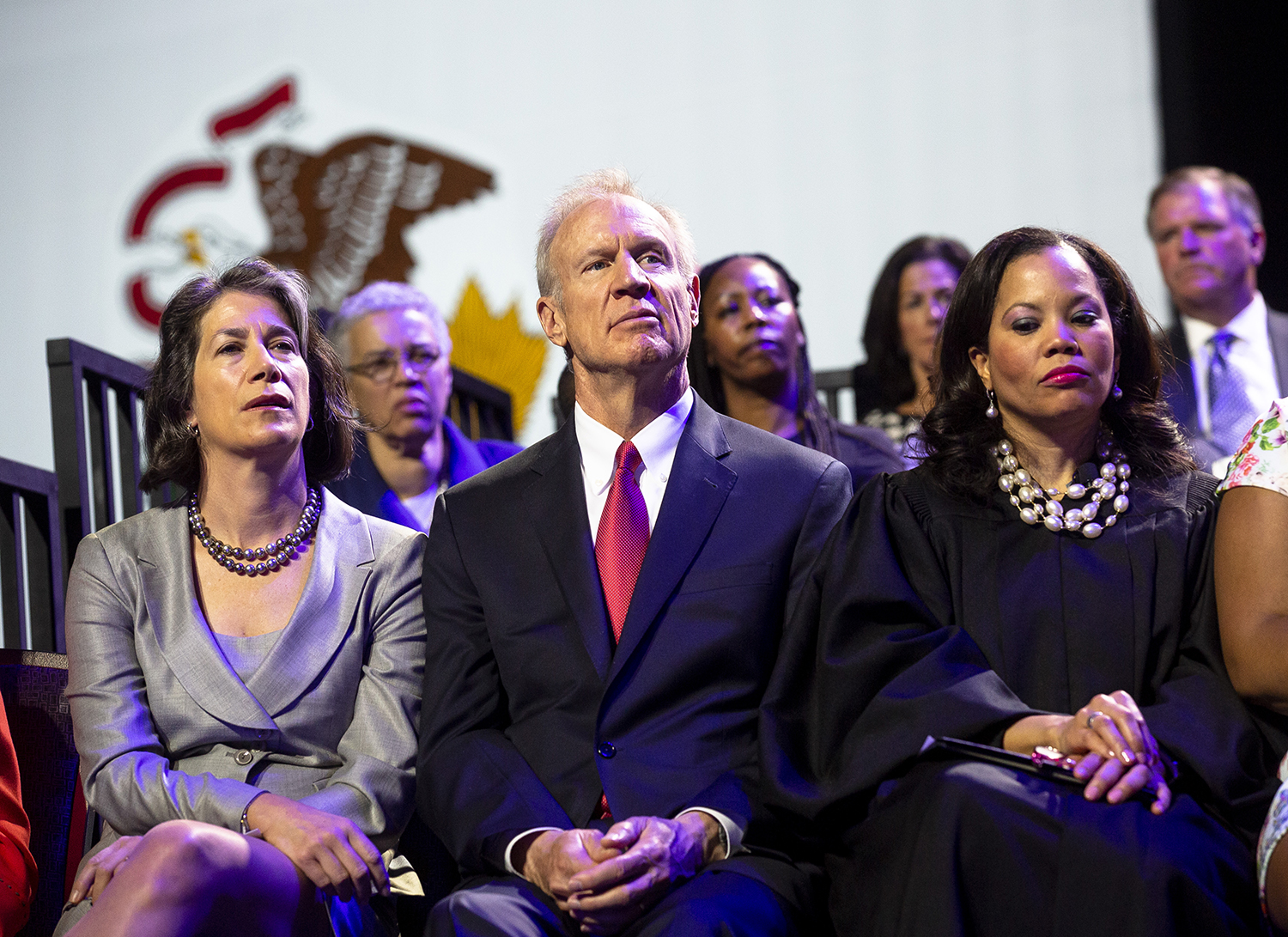Gov. Bruce Rauner and his wife Diana, left, listen to inaugural speeches during the Illinois Inaugural Ceremony Monday, Jan. 14, 2019 a the Bank of Springfield Center in Springfield, Ill. [Rich Saal/The State Journal-Register]