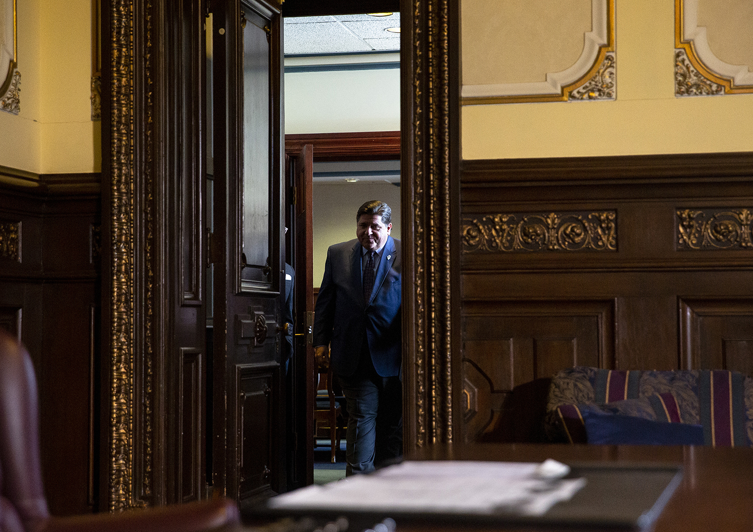 Gov. J.B. Pritzker enters his office on his first full day in office to sign a package of legislation and executive orders designed to raise wages Tuesday, Jan. 15, 2019 at the Capitol in Springfield, Ill. [Rich Saal/The State Journal-Register]