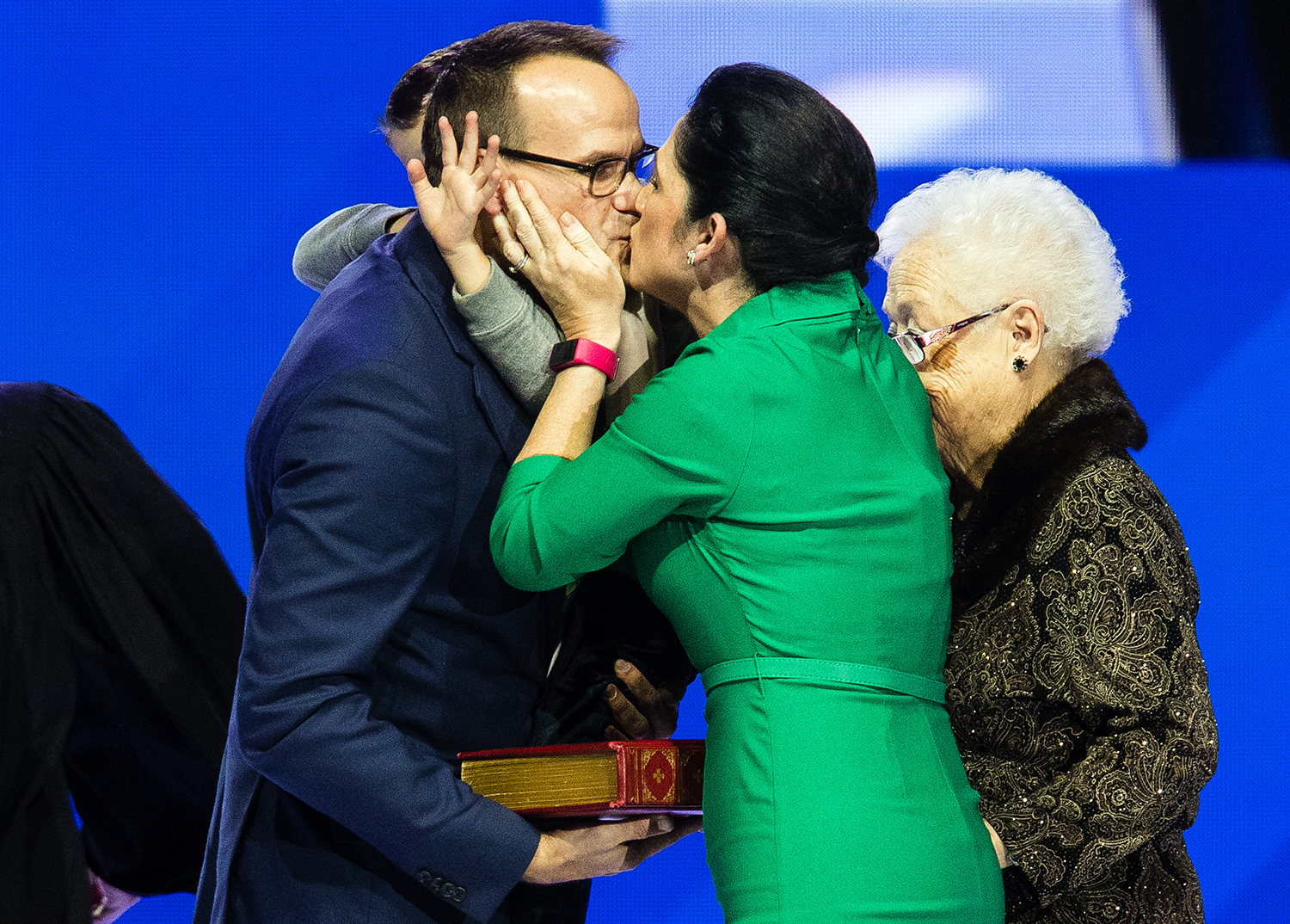 Comptroller Susana Mendoza kisses her husband David Szostak as their son David gets caught in the middle and raises his hand during the Illinois Inaugural Ceremony at the Bank of Springfield Center Monday, Jan. 14, 2019. [Ted Schurter/The State Journal-Register]