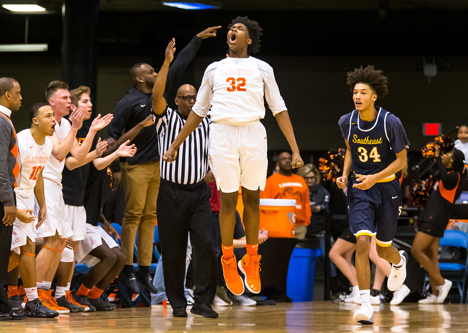 Lanphier's KJ Debrick (32) reacts after hitting a 3-pointer against Southeast in the third quarter on opening night of the Boys City Tournament at the Bank of Springfield Center, Wednesday, Jan. 16, 2019, in Springfield, Ill. [Justin L. Fowler/The State Journal-Register]