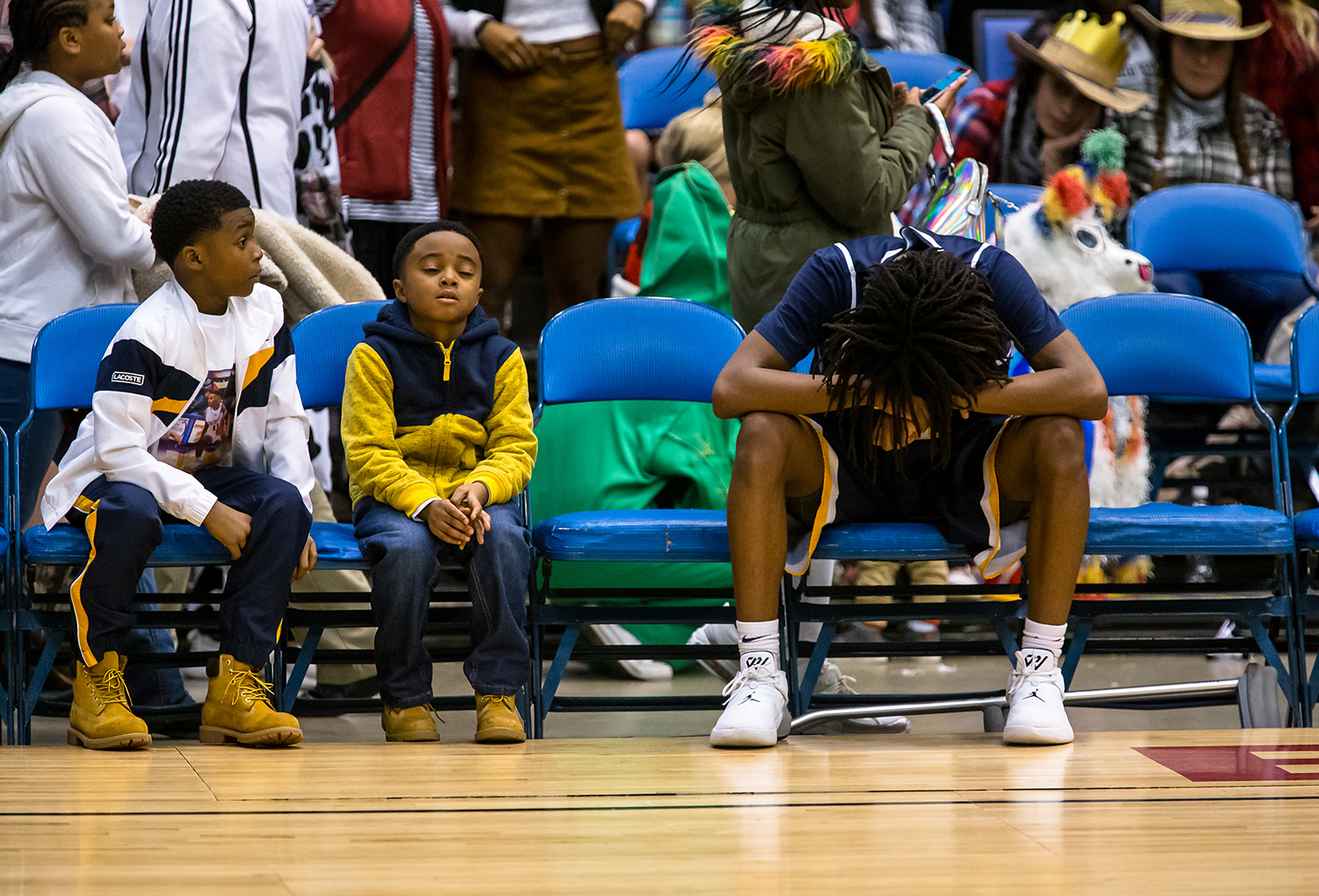 Southeast's Terrion Murdix (4) puts his head down on the bench as the Spartans watch Southeast's Herb McMath (41) get medical attention after an injury in the second quarter on opening night of the Boys City Tournament at the Bank of Springfield Center, Wednesday, Jan. 16, 2019, in Springfield, Ill. [Justin L. Fowler/The State Journal-Register]