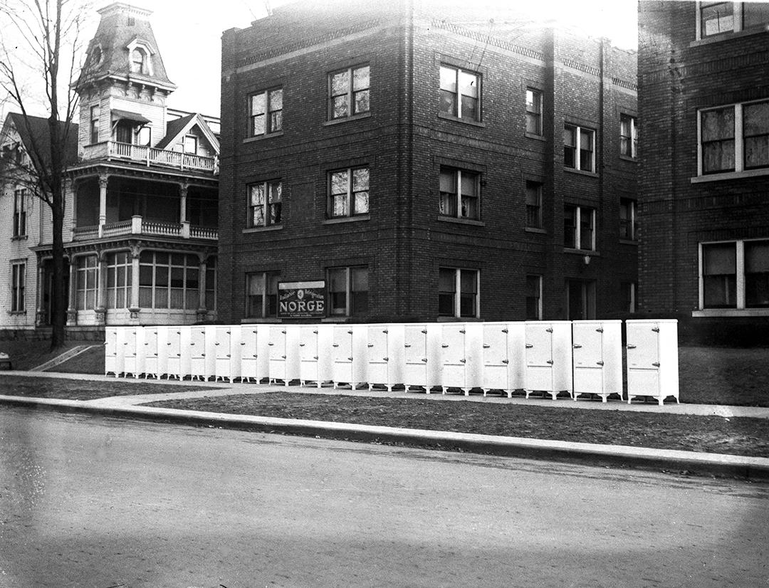 Plaza Apartment Building, 1008-1018 S. Seventh Street. Display of Norge refrigerators to be installed. J.T. Peters mansion in background.  Illinois State Journal/Register glass plate negative/Sangamon Valley Collection at Lincoln Library  C-98-078  neg.# 1967   VF 2007-276  1/2