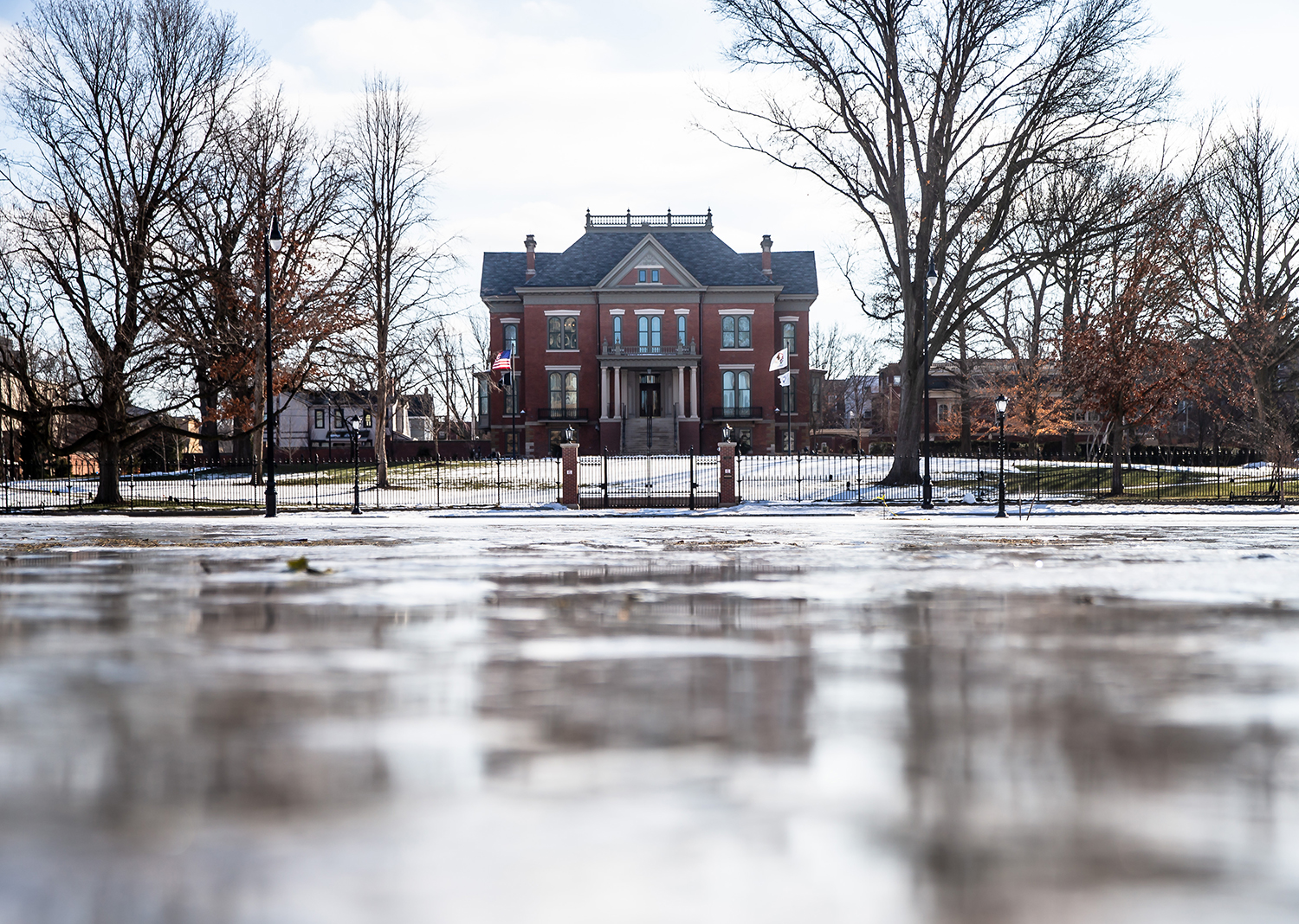 The Illinois Governor's Mansion is reflected in a layer of ice covering the Y-block, Thursday, Jan. 24, 2019, in Springfield, Ill. The week of weather that saw rain and melting snow followed by plummeting temperatures has created icy landscapes across the area. [Justin L. Fowler/The State Journal-Register]