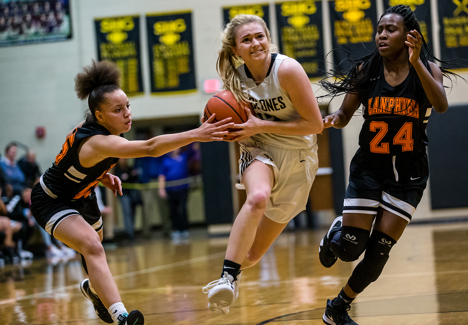 Sacred Heart-Griffin's Payton Vorreyer (13) drives in to the basket against Lanphier's Martrice Brooks (24) in the second half on the opening night of the Girls City Tournament at Sacred Heart-Griffin's West Campus, Wednesday, Jan. 23, 2019, in Springfield, Ill. [Justin L. Fowler/The State Journal-Register]