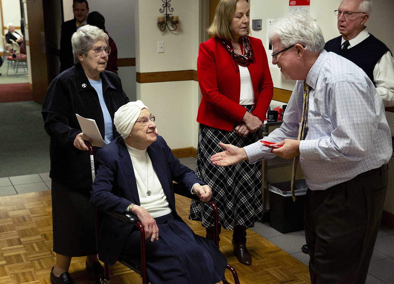 Peter Manix greets Sister Marianna Kosior, OSF, during a reception marking the 40th anniversary of the creation of the Hospital Sisters Health System Tuesday, Jan. 22, 2019 at the HSHS corporate office in Springfield, Ill. Kosior was the first president and CEO of HSHS and guided the creation of the corporation that operates HSHS St. John's Hospital, and 14 others in Illinois and Wisconsin. Of the five sisters who created the corporation, four of them attended the reception, including Sister Jomary Trstensky, who is behind Kosior. [Rich Saal/The State Journal-Register]