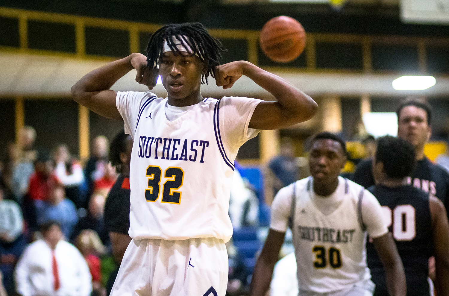 Southeast's Stepheon Sims (32) flexes after making a basket and drawing a foul against Springfield in the first half at Southeast High School, Tuesday, Feb. 5, 2019, in Springfield, Ill. [Justin L. Fowler/The State Journal-Register]