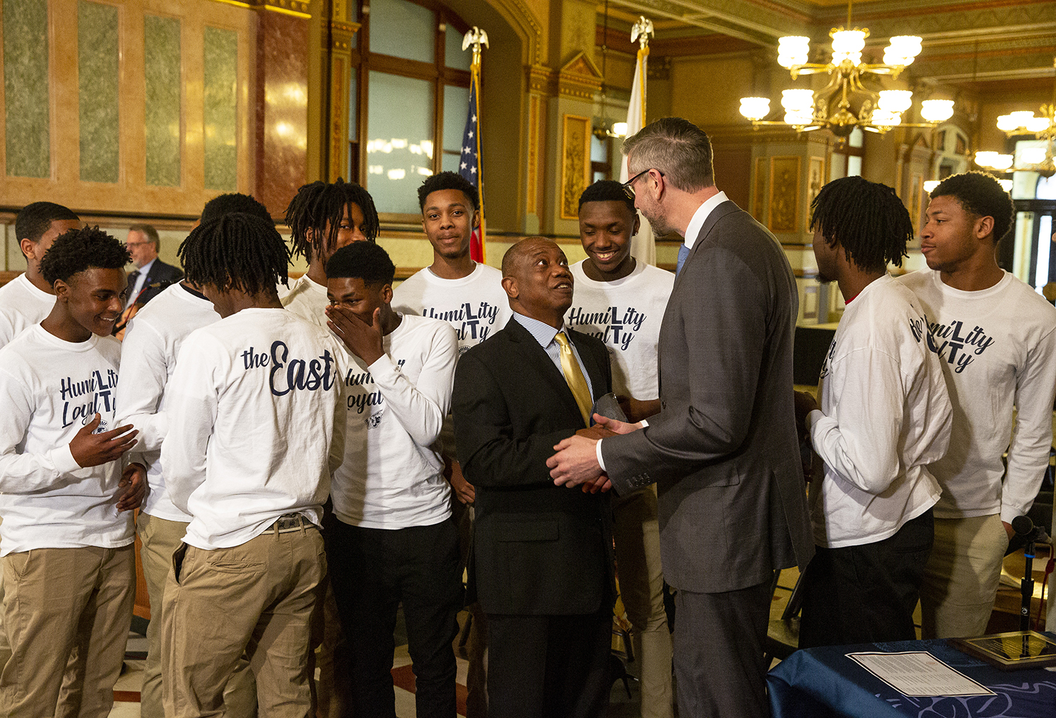 Southeast High School boys basketball coach Lawrence Thomas speaks with State Treasurer Michael Frerichs after Thomas was honored for outstanding achievement in sportsmanship during a ceremony in celebration of Black History Month hosted by the treasurer Wednesday, Feb. 6, 2019 at the Capitol in Springfield, Ill. Thomas is surrounded by the Southeast basketball team. Seven African Americans from across the state were recognized for outstanding achievements, including Deanna Blackwell, director of Student Support Services at Lincoln Land Community College. [Rich Saal/The State Journal-Register]