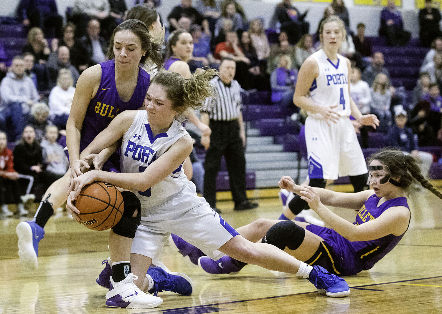 PORTA's Kyia Privia wrests the ball away from Williamsville's Addison Woods during the 2A Williamsville Regional at Williamsville High School Thursday, February 7, 2019. [Ted Schurter/The State Journal-Register]