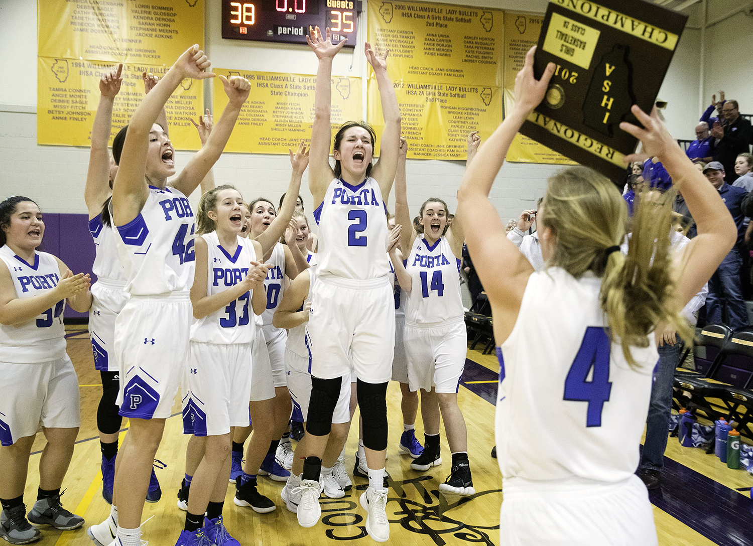 The PORTA Blue Jays celebrate as Taylor Danner brings the regional championship plaque over after they defeated Williamsville 38-35 during the 2A Williamsville Regional Thursday, February 7, 2019. [Ted Schurter/The State Journal-Register]