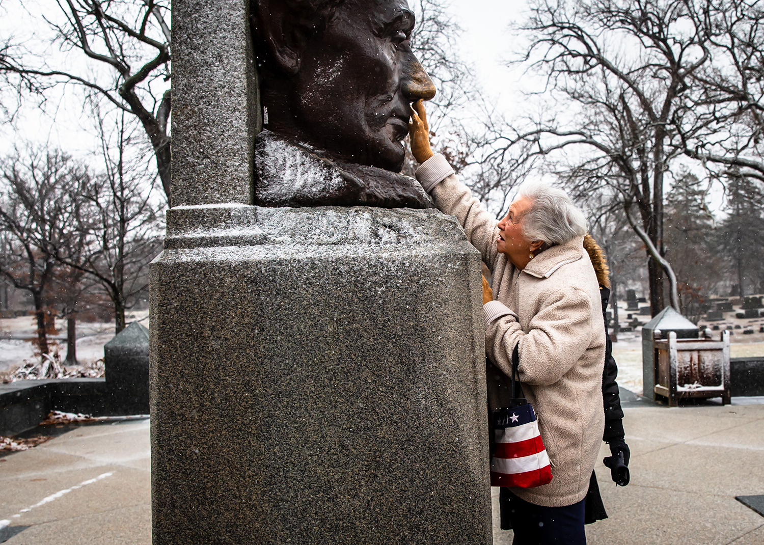 "Virginia Ball, of El Dorado, Kansas, gets a bit of good luck from the nose of Abraham Lincoln as she visits the Lincoln Tomb State Historic Site for the first time with American Legion Post 81 during the 85th annual American Legion Pilgrimage to Lincoln's Tomb, Tuesday, Feb. 12, 2019, in Springfield, Ill. ""I want my family to come back, there is so much to learn from here,"" said Ball of visiting the site for the first time. ""It's wonderful and I want to come back, but I'm 93 so I hope get to."" [Justin L. Fowler/The State Journal-Register]"