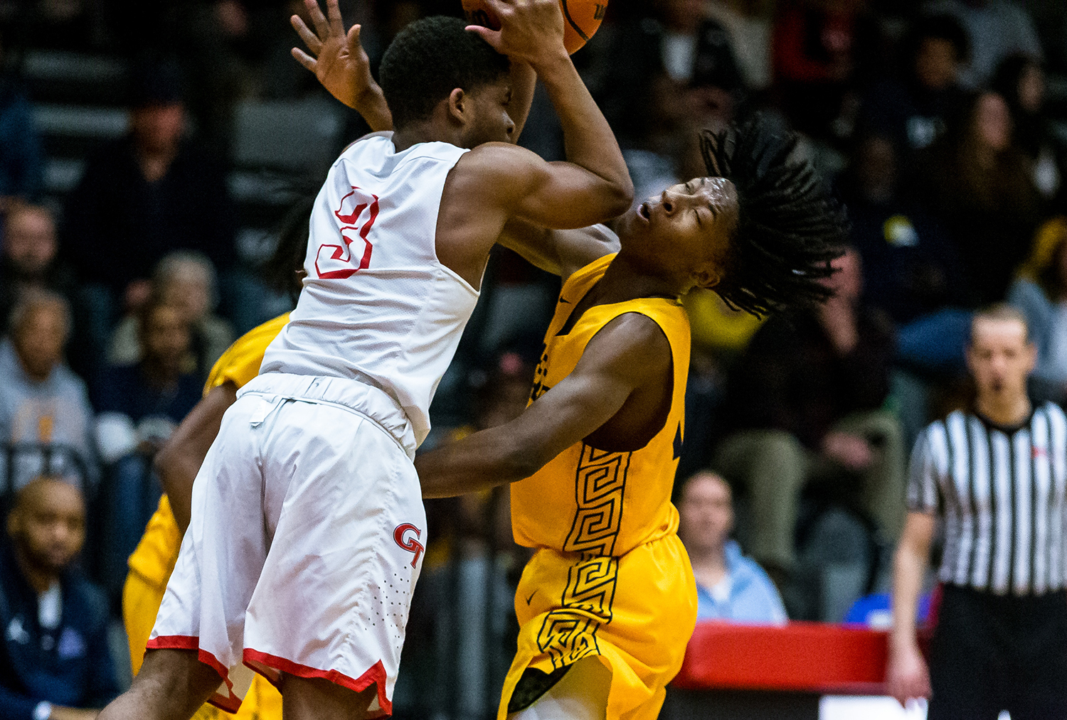 Southeast's Stepheon Sims (32) takes an elbow from Glenwood's Jason Hansbrough (3) while trying to force a turnover in the second half at Glenwood High School, Tuesday, Feb. 12, 2019, in Chatham, Ill. [Justin L. Fowler/The State Journal-Register]