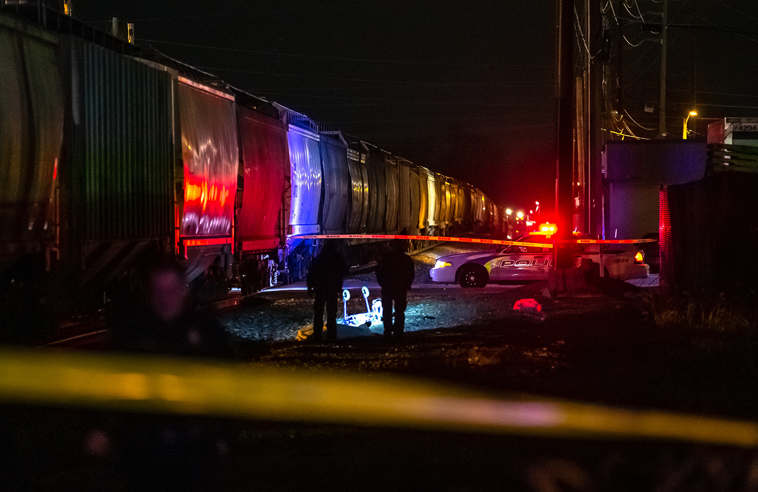 Springfield Police Officers work the scene of an accident reportedly involving a pedestrian versus a train at the intersection of North Eleventh Street and East Jefferson Street, Wednesday, Feb. 13, 2019, in Springfield, Ill. [Justin L. Fowler/The State Journal-Register]