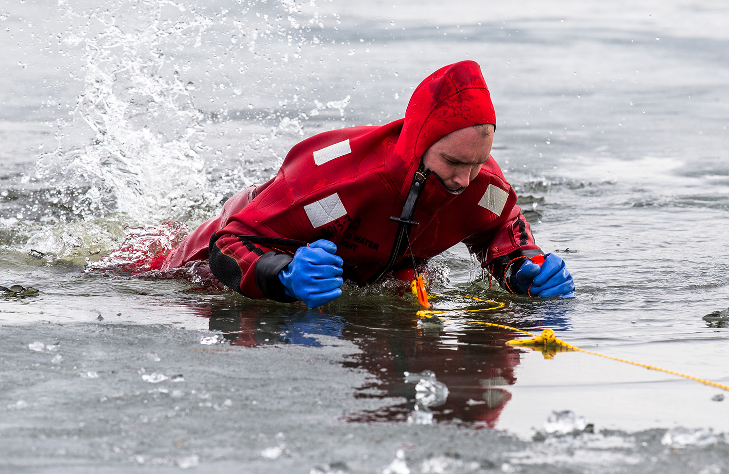 "Springfield firefighter Dan Gorton uses ice picks to pull himself out from a hole in the ice while wearing a cold water rescue suits during training at the pond at Knights Action Park, Wednesday, Jan. 31, 2018, in Springfield, Ill. ""This is part of the job we hope we never have to use,"" said Gorton. ""But this is great training."" Firefighters throughout the department goes through the annual ice training that gives them invaluable experience in rescue techniques while using the cold water rescue suits. [Justin L. Fowler/The State Journal-Register]"