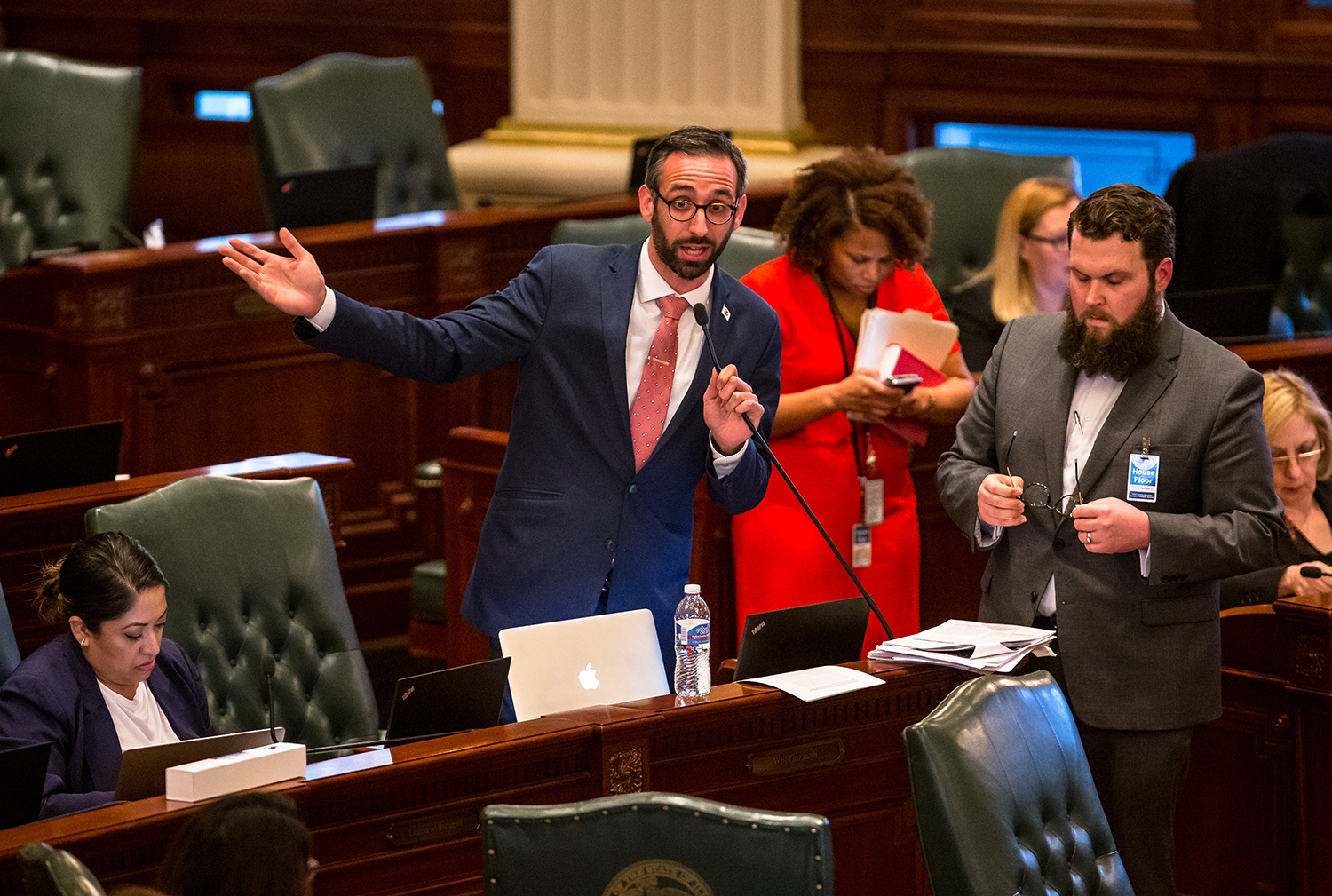 Illinois State Rep. Will Guzzardi, D-Chicago, answers questions from the Republican side of the aisle during debate on the House floor for Senate Bill 1, the bill to raise the minimum wage to $15 by 2025, at the Illinois State Capitol, Thursday, Feb. 14, 2019, in Springfield, Ill. [Justin L. Fowler/The State Journal-Register]