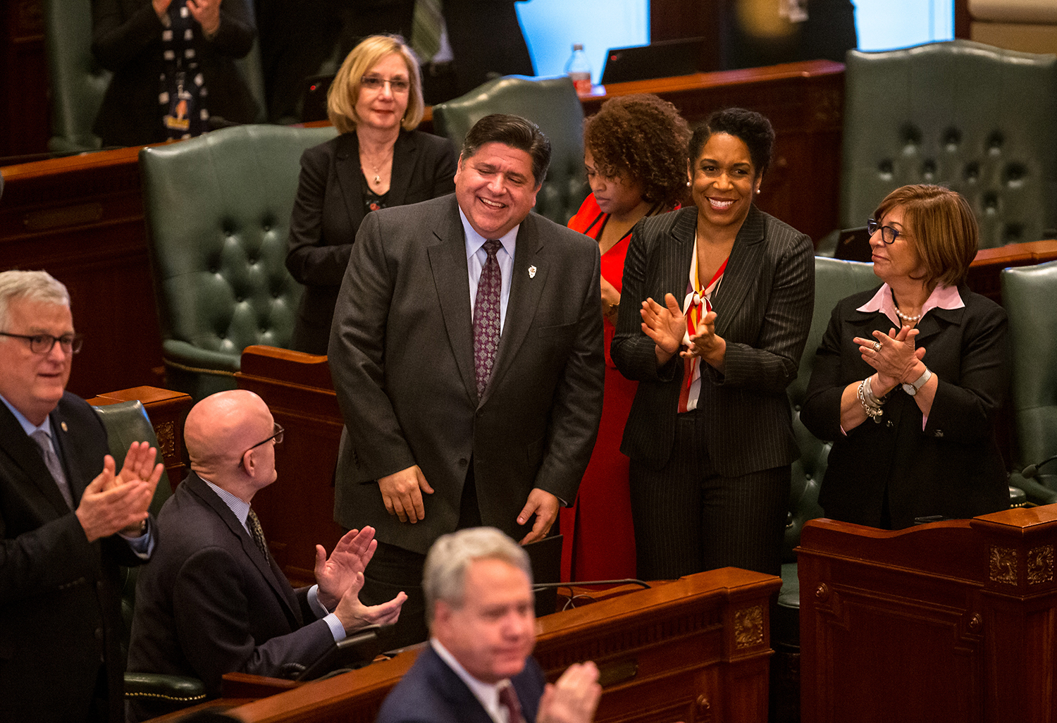 Illinois Governor JB Pritzker, left, and Illinois Lt. Gov. Juliana Stratton, right, are acknowledged for their presence on the House floor after Senate Bill 1, a bill to raise the minimum wage to $15 by 2025, passed the House with a vote of 69-47 at the Illinois State Capitol, Thursday, Feb. 14, 2019, in Springfield, Ill. [Justin L. Fowler/The State Journal-Register]