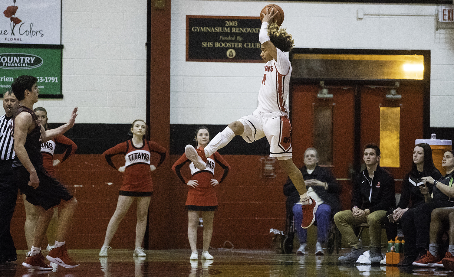 Springfield's Zaire Harris leaps for a high pass at Springfield High School Friday, Feb. 15, 2019. [Ted Schurter/The State Journal-Register]